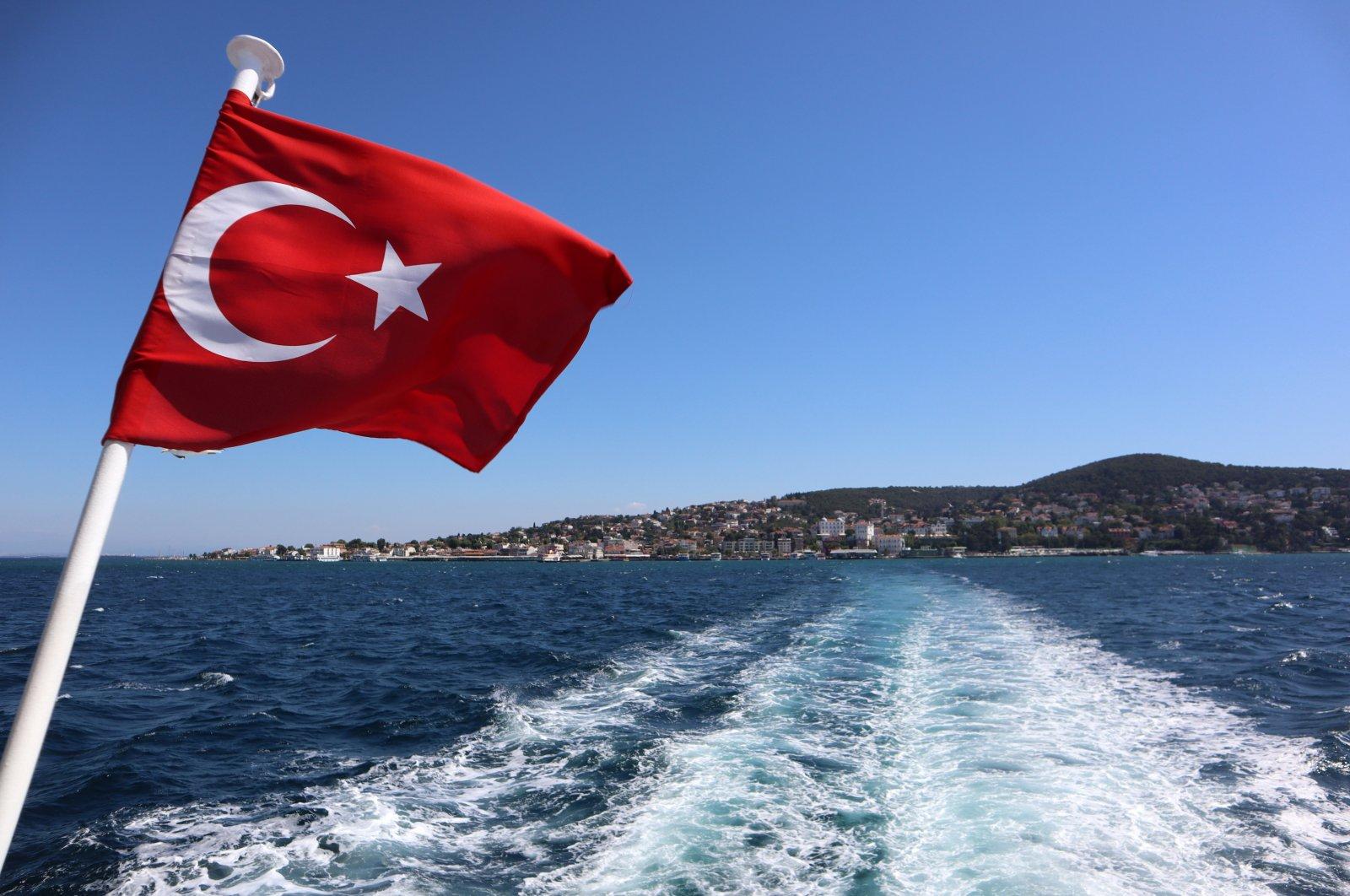 The Turkish flag waves on a Bosporus ferry from Büyükada in the Marmara Sea, Istanbul, Turkey, March 12, 2019. (Photo by Shutterstock)