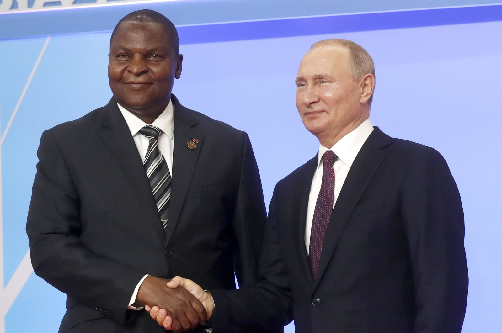 Russian President Vladimir Putin (R) and President of the Central African Republic Faustin Archange Touadera pose for a photo during a welcome ceremony of the Russia-Africa summit in the Black Sea resort of Sochi, Russia, Oct. 23, 2019. (AP Photo)