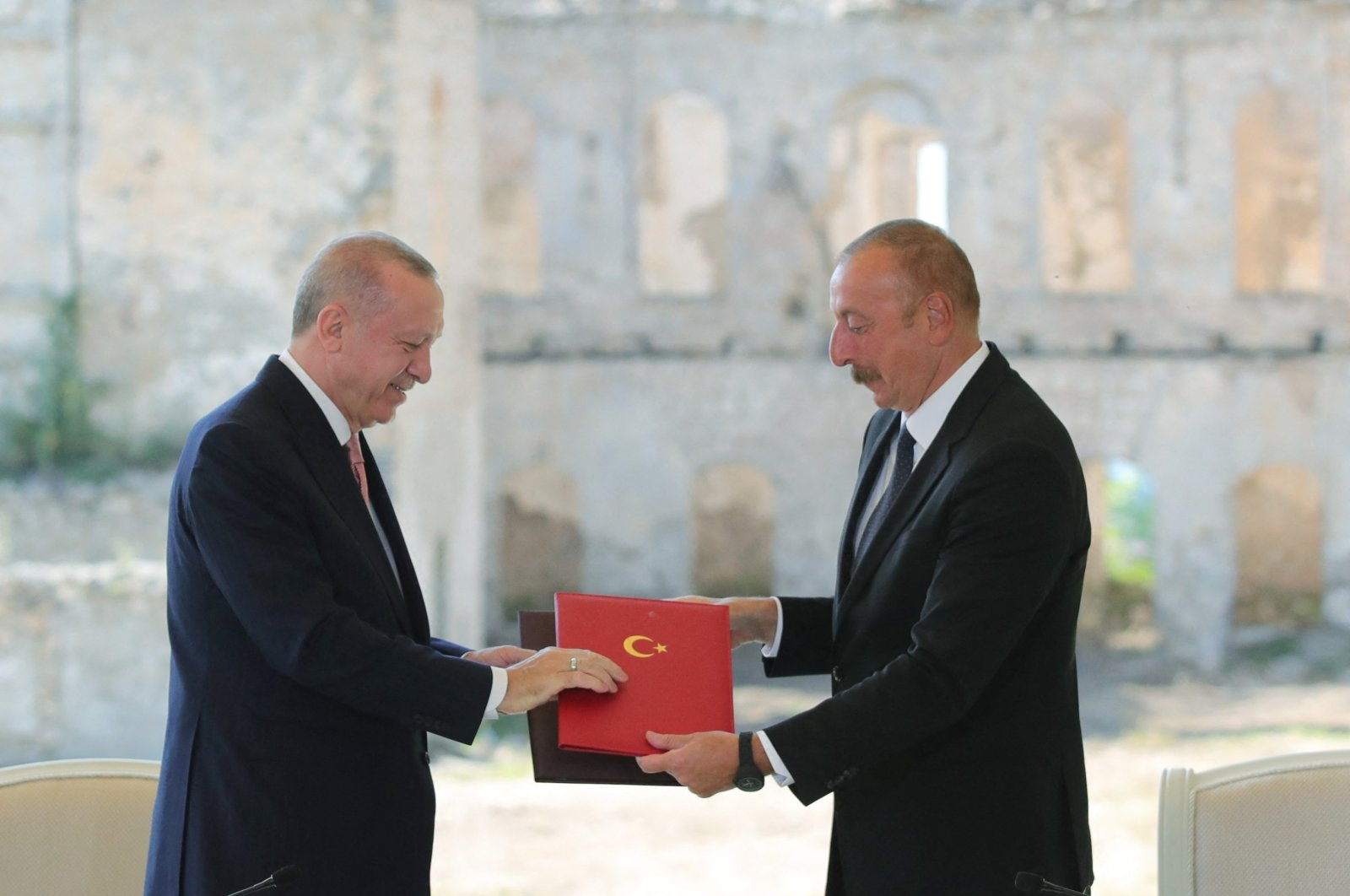 Azerbaijani President Ilham Aliyev (R) and Turkish President Recep Tayyip Erdoğan (L) exchange the signed  'Shusha Declaration' in Shusha, Azerbaijan, June 15, 2021. (handout photo released by the Turkish President's Press Office)