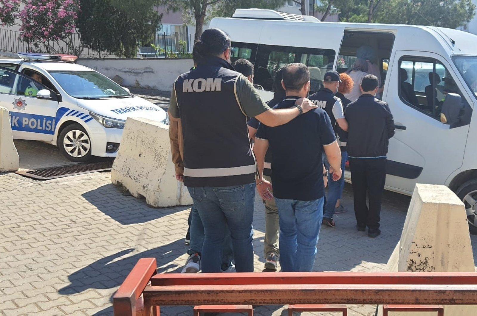 Police escort captured suspects to a van in Ayvalık, Balıkesir, northwestern Turkey, June 18, 2021. (İHA PHOTO)