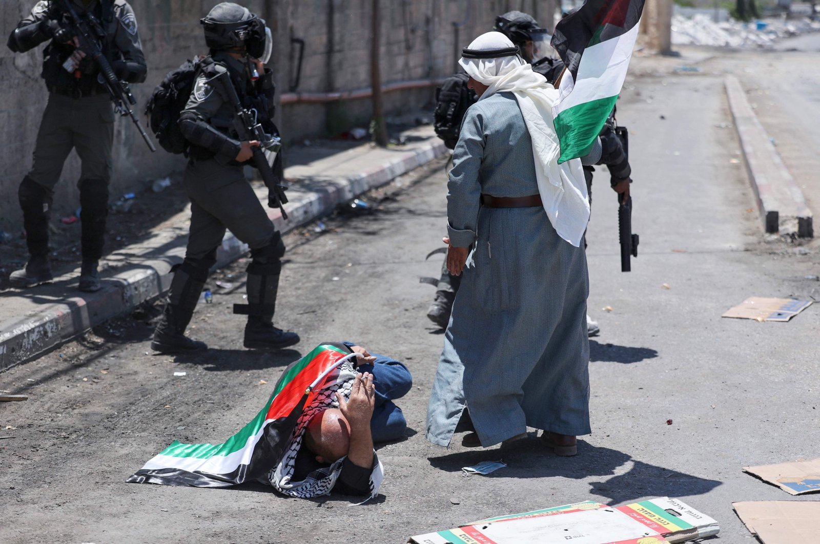 A Palestinian protester lies on the ground after being pushed by Israeli security forces amid clashes following a demonstration against Israeli settlements in the village of Beita, south of Nablus in the occupied West Bank, Palestine, June 18, 2021. (AFP Photo)