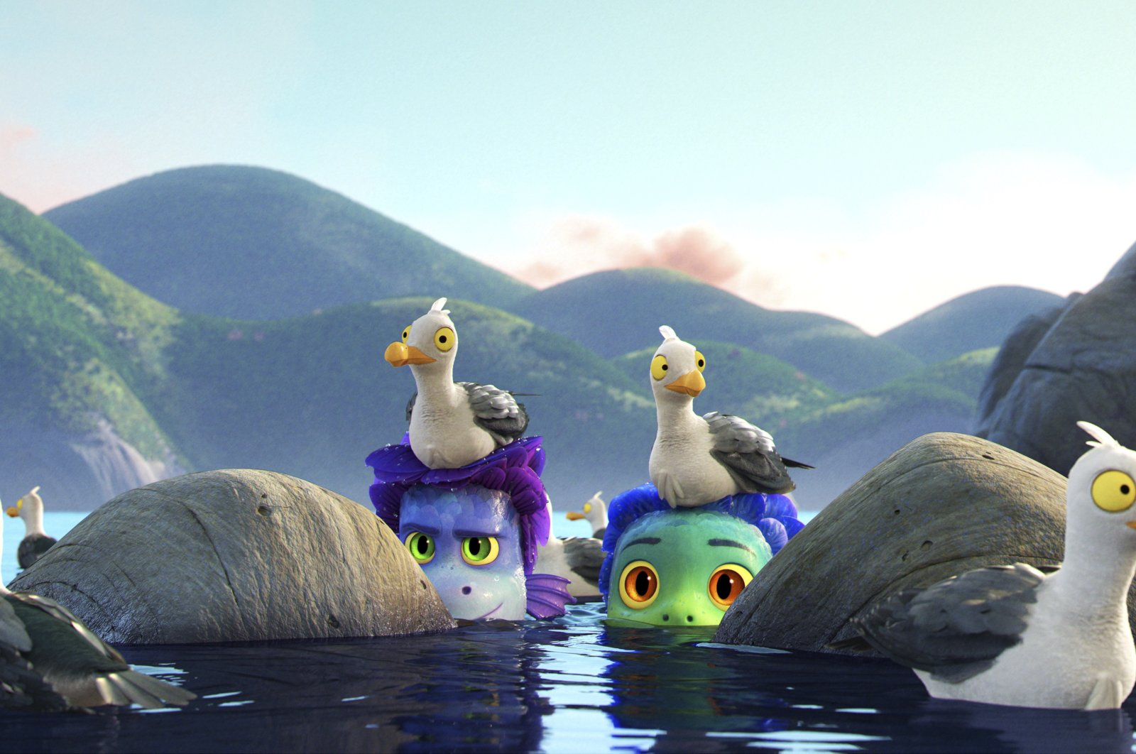 """Alberto (C-L), voiced by Jack Dylan Grazer, and Luca (C-R), voiced by Jacob Tremblay, come out of the water as they are surrounded by seagulls in a scene from the animated film """"Luca."""" (Photo by Disney via AP)"""