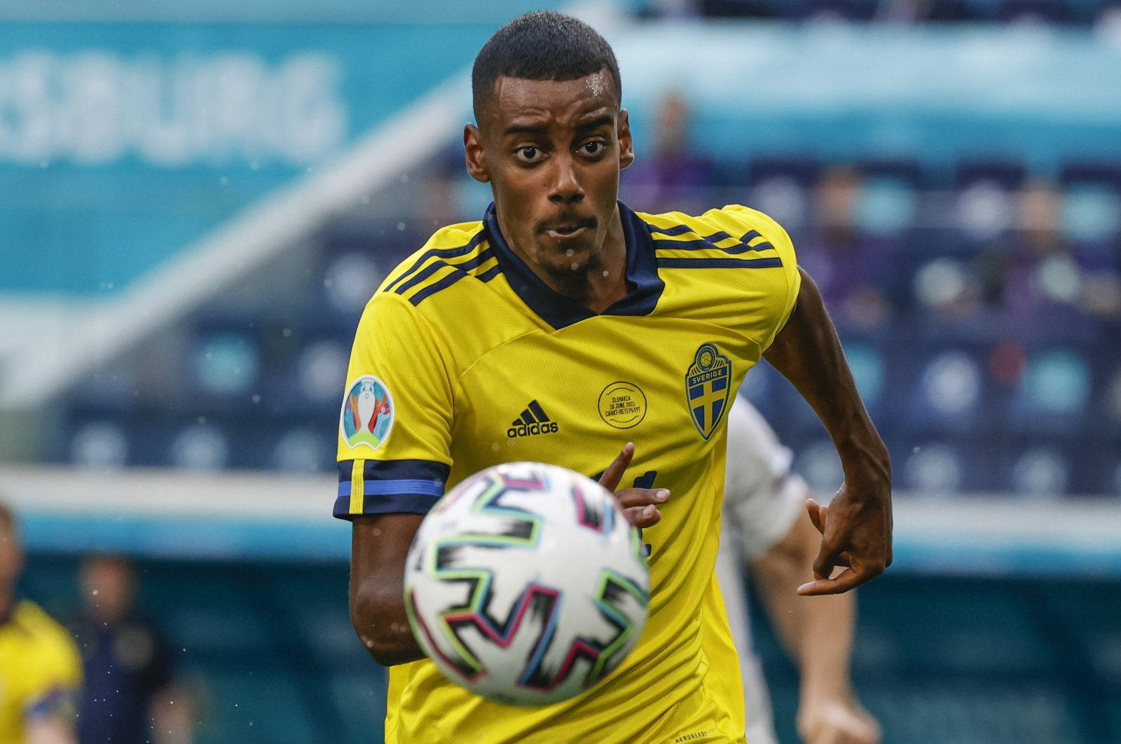 Sweden's Alexander Isak keeps his eyes on the ball during the Euro 2020 football championship group E match between Sweden and Slovakia, at Saint Petersburg Stadium, in Saint Petersburg, Russia, June 18, 2021. (AP Photo)
