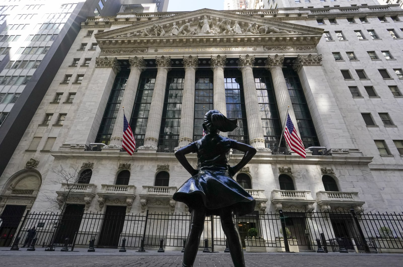The Fearless Girl statue stands in front of the New York Stock Exchange in the Financial District of New York City, New York, U.S., March 23, 2021. (AP Photo)