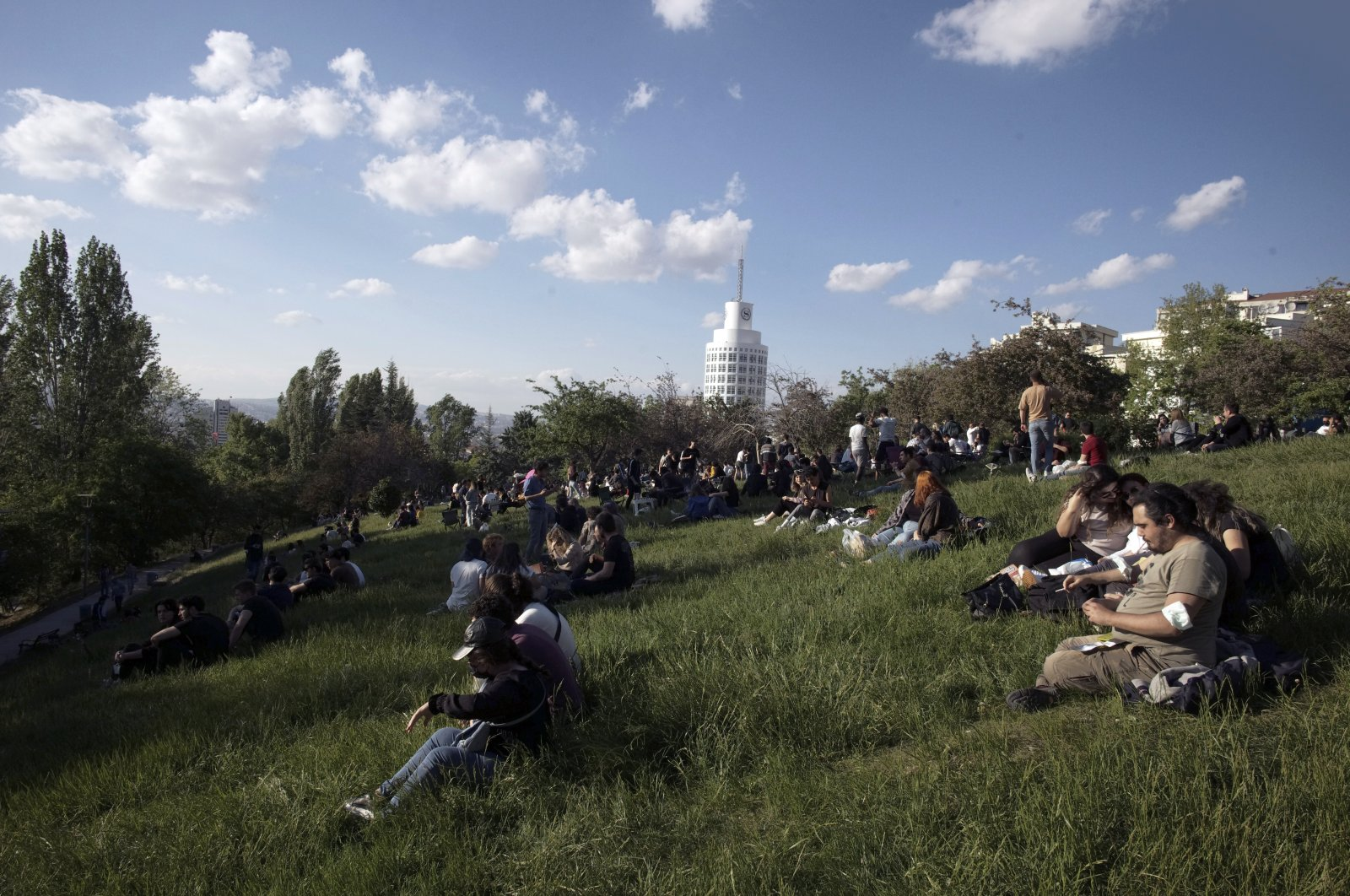 People enjoy good weather at a park, hours after a 17-day full lockdown ended, in Ankara, Turkey, May 17, 2021. (AP Photo)
