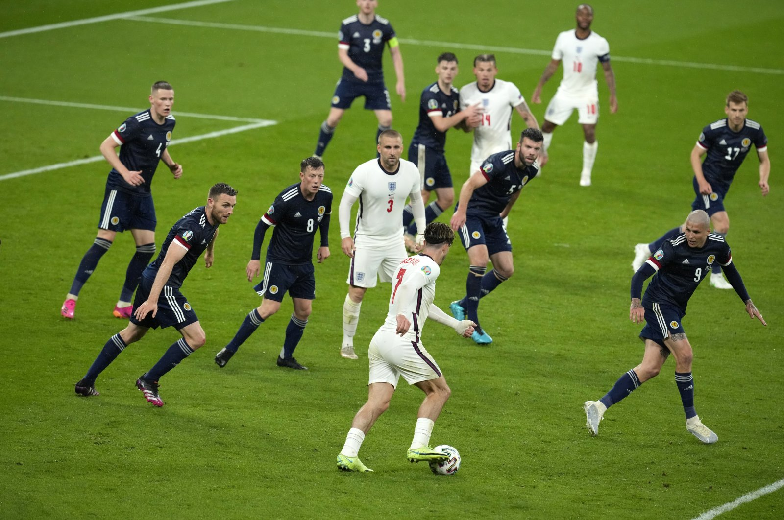 England's Jack Grealish (C foreground) controls the ball during the Euro 2020 soccer championship group D match between England and Scotland, at Wembley Stadium, in London, England, June 18, 2021. (AP Photo)