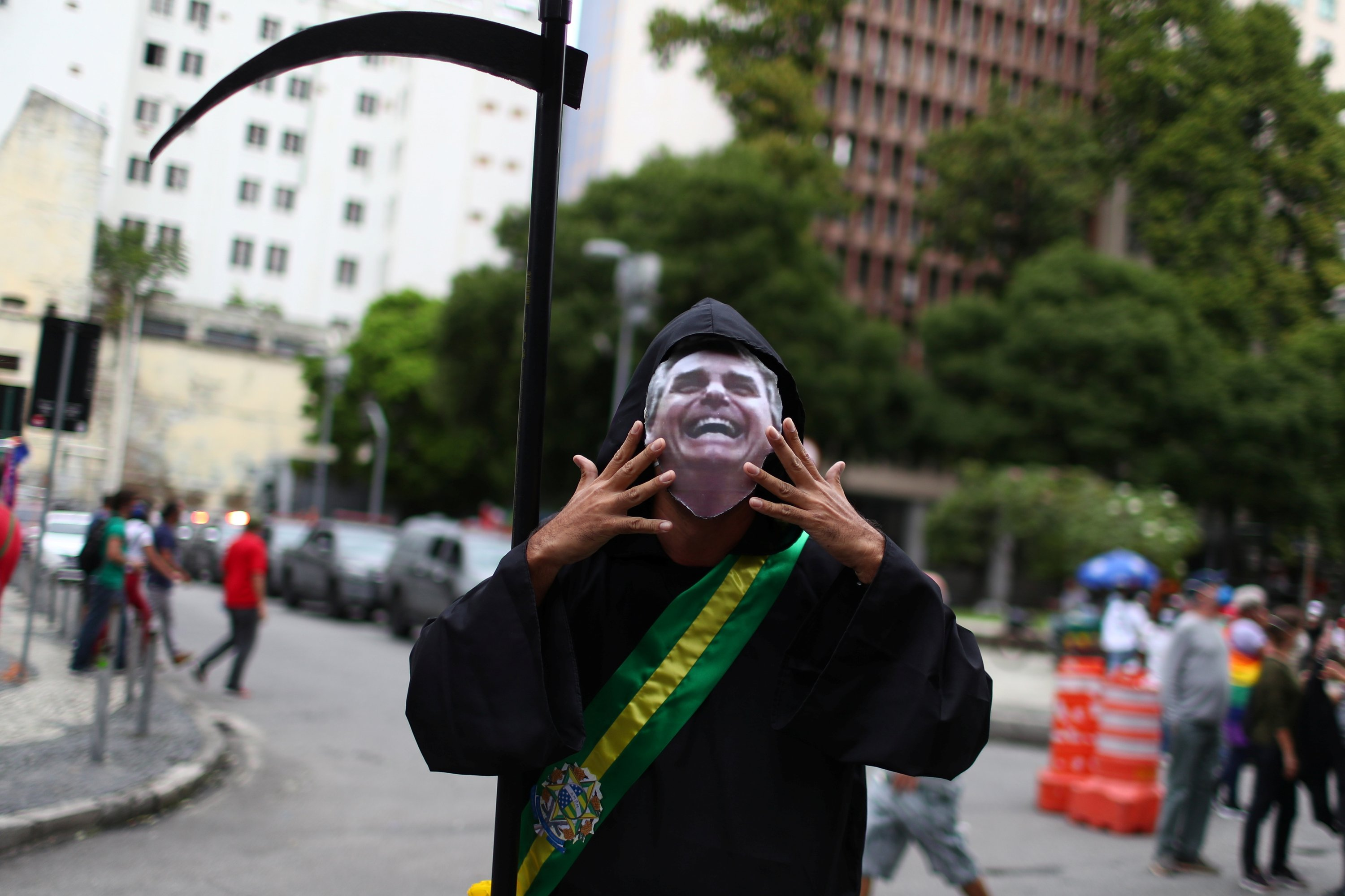 A person dressed up as the grim reaper attends a demonstration against Brazil's President Jair Bolsonaro's handling of the COVID-19 pandemic and to impeach him, in Rio de Janeiro, Brazil, June 19, 2021. (Reuters Photo)