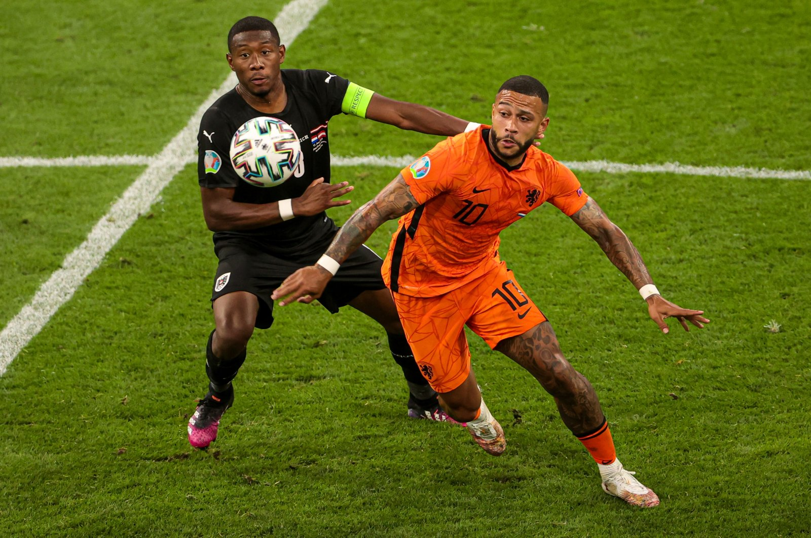 Dutch forward Memphis Depay (R) vies for the ball during Euro 2020 Group C match against Austria, at Amsterdam Arena in the Netherlands, June 18, 2021. (AA Photo)