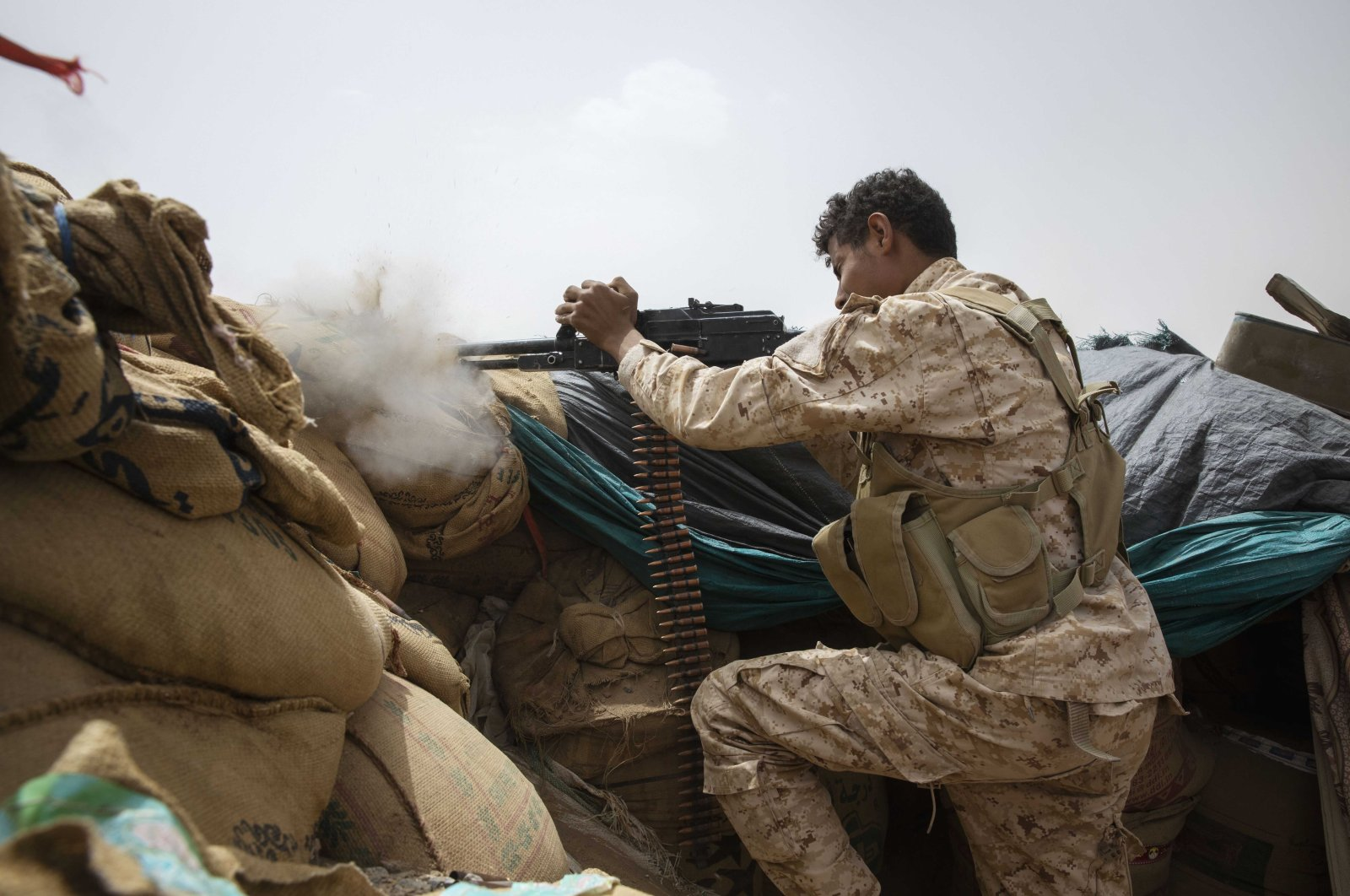 A Yemeni fighter backed by the Saudi-led coalition fires his weapon on the front lines of Marib, Yemen, June 19, 2021. (AP Photo)
