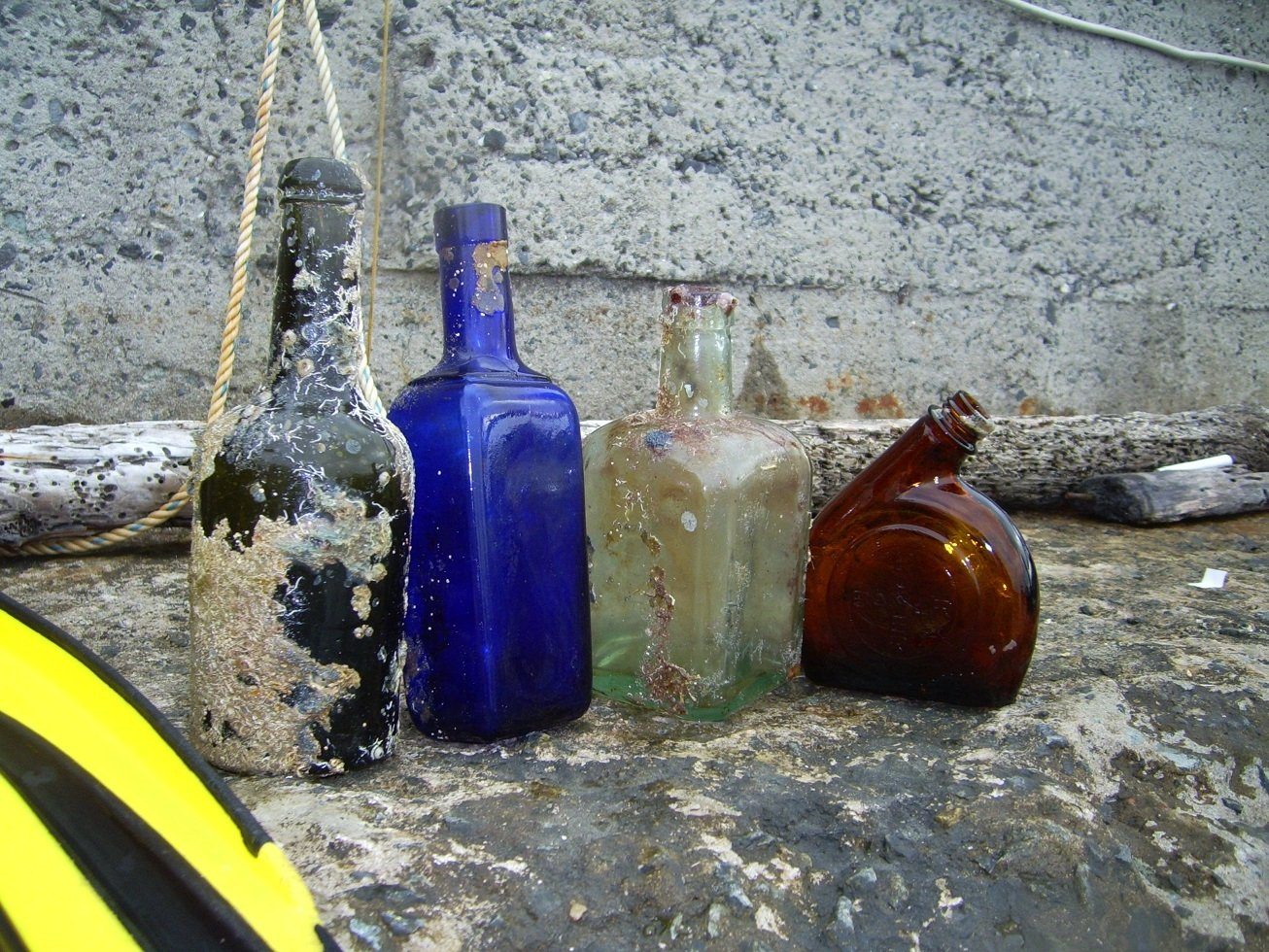 Historic bottles Hakan Kabasakal retrieved from the Bosporus are displayed on a ledge, in Istanbul, Turkey, June 20, 2021. (DHA PHOTO)