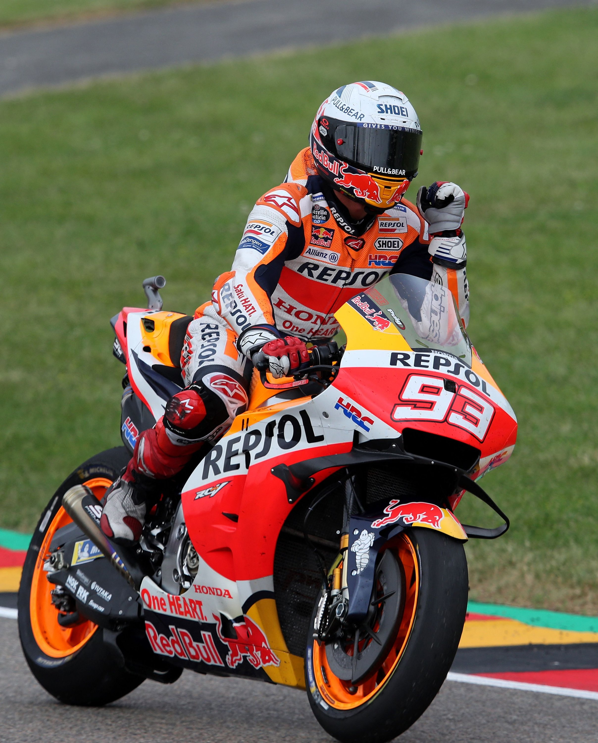 Repsol Honda Team's Spanish MotoGP rider Marc Marquez celebrates winning the Motorcycling Grand Prix of Germany at the Sachsenring racing circuit, Hohenstein-Ernstthal, Germany, June 20, 2021. (AFP Photo)