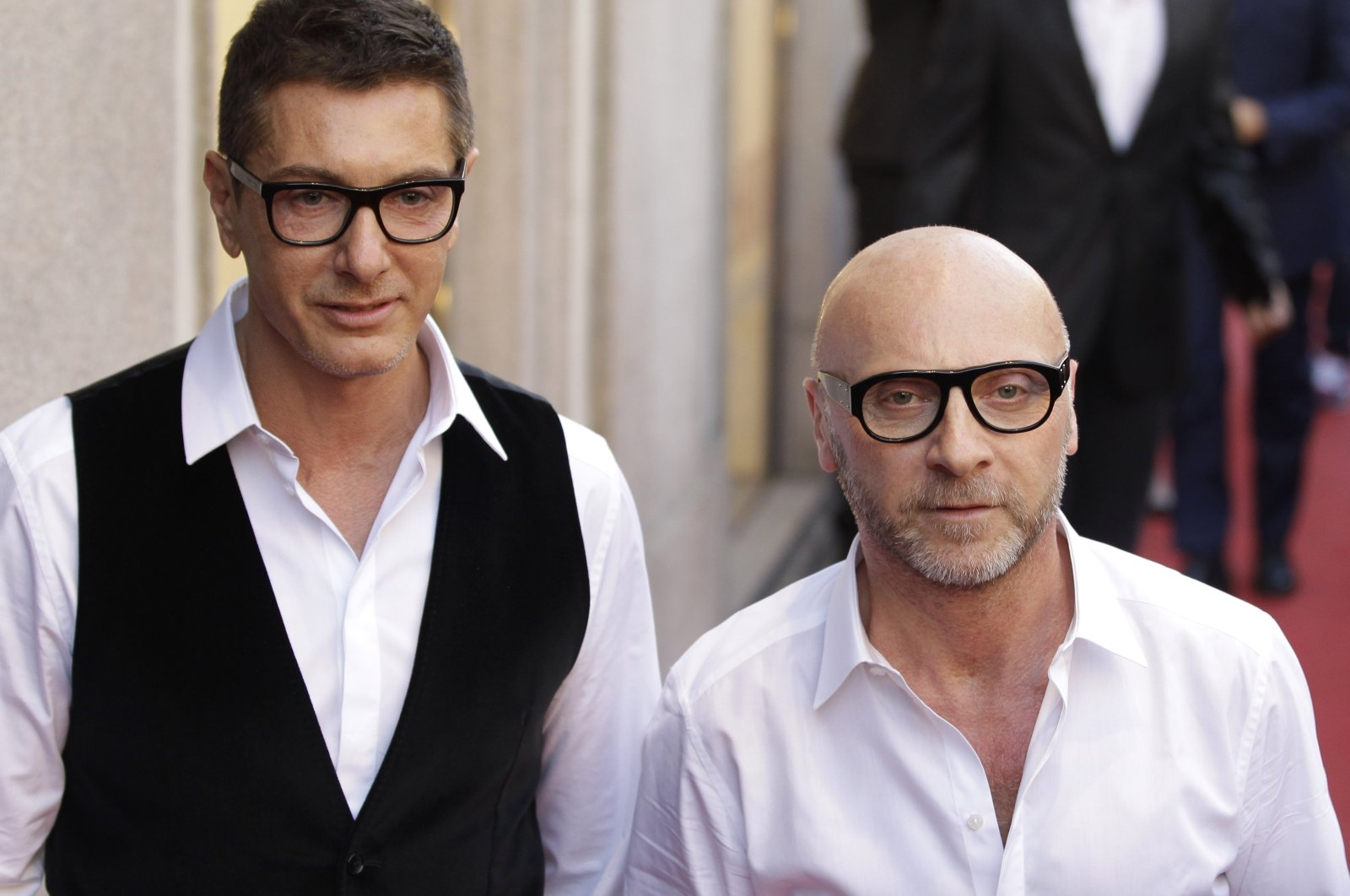 Fashion designers Stefano Gabbana (L) and Domenico Dolce arrive in downtown Milan, Italy, May 19, 2011. (AP Photo)