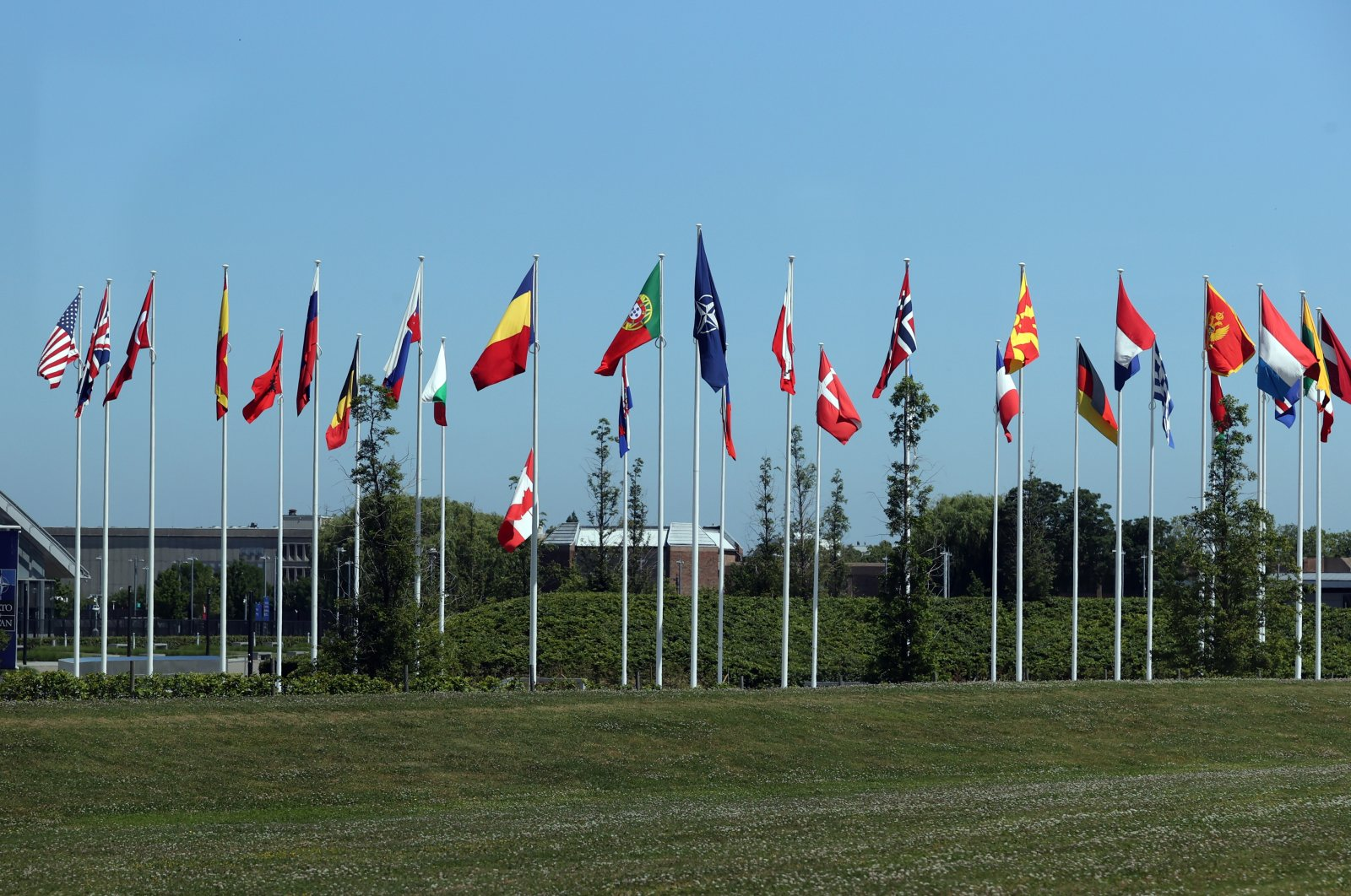 A view of flags of NATO member states waving at the NATO headquarters, Brussels, Belgium, June 13, 2021. (AA Photo)