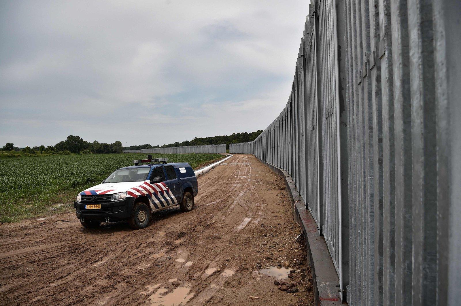 A Frontex car patrols a steel fence along the Maritsa (Meriç) River, Greece's river border with Turkey, near the village of Poros, June 8, 2021. (AFP Photo)