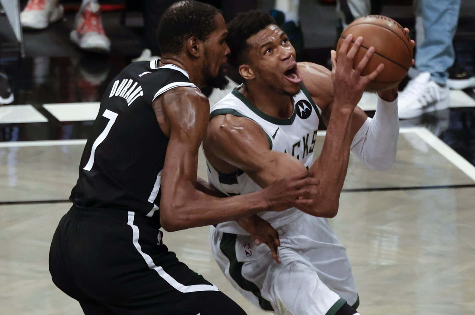 Milwaukee Bucks forward Giannis Antetokounmpo (R) looks to put up a shot past a defending Brooklyn Nets forward Kevin Durant (L) in the second half of Game 7 of the 2021 NBA Eastern Conference semifinals at the Barclays Center, Brooklyn, New York, U.S., June 19, 2021. (EPA Photo)