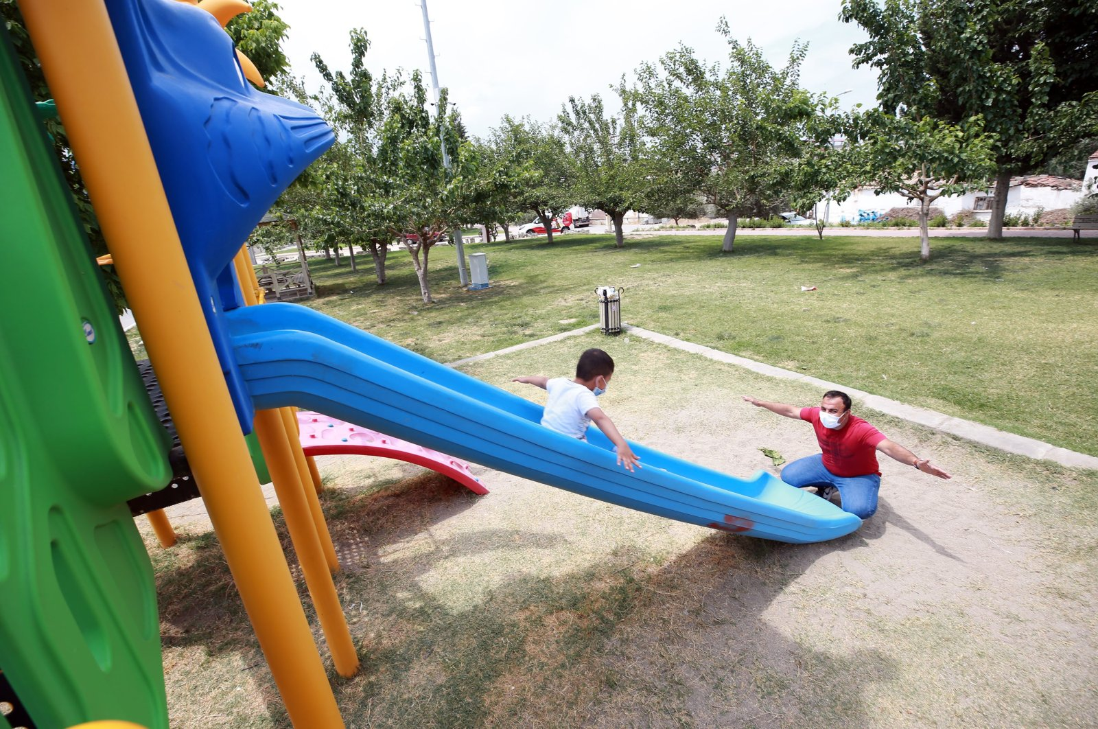 Muammer Yalçın plays with his son at a playground, in Aydın, western Turkey, June 20, 2021. (AA PHOTO)