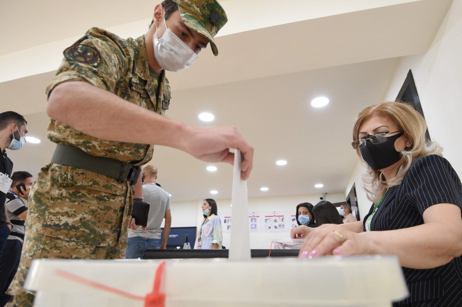 A soldier casts his ballot at a polling station during early parliamentary elections in Yerevan on June 20, 2021. (AFP Photo)