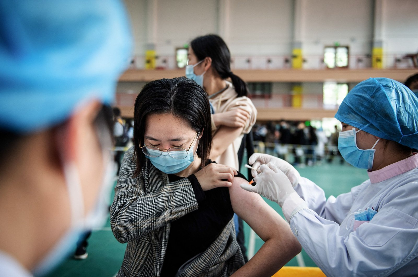 A university student receives the China National Biotec Group (CNBG) COVID-19 vaccine at a university in Wuhan, in China's central Hubei province, April 28, 2021. (AFP Photo)