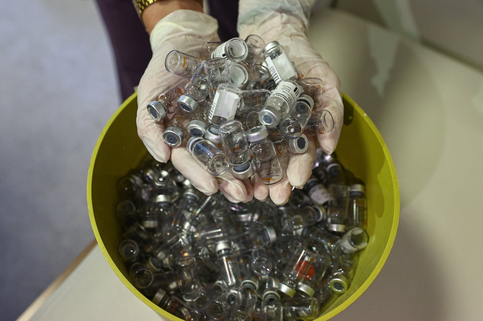 A nurse shows empty vaccine bottles used in an inoculation drive at a hospital, in Izmir, western Turkey, June 20, 2021. (AA PHOTO)