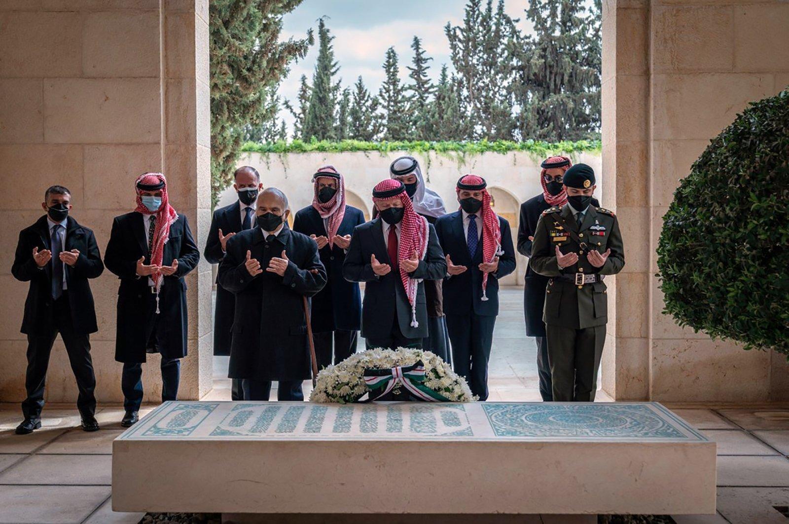 Jordan's King Abdullah II (C), Prince Hamzah (2L) and others during a visit to the tomb of the late King Hussein, Amman, Jordan,  April 11, 2021. (AP Photo)