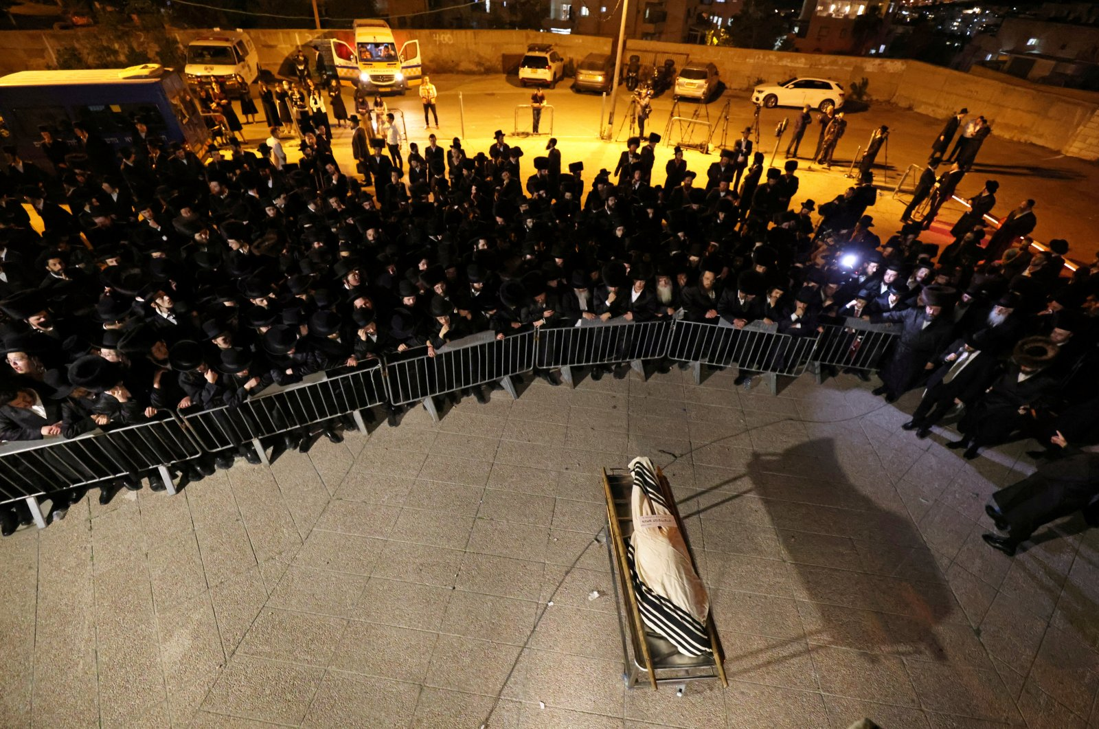 The body of Menahem Kanovlowitz, who died in a stampede at an ultra-Orthodox Jewish festival on the slopes of Israel's Mount Meron, is surrounded by mourners during his funeral in Jerusalem, May 1, 2021. (Reuters Photo)