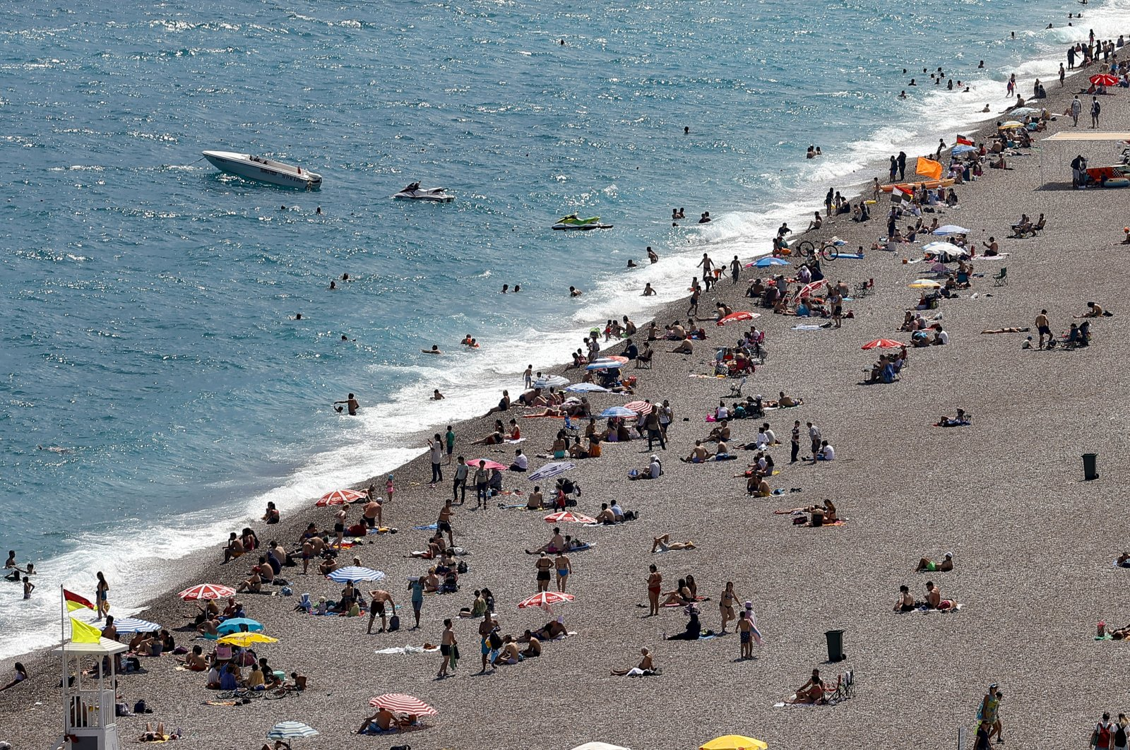 People are seen on a beach in the southern Mediterranean resort city of Antalya, Turkey, June 12, 2021. (AA Photo)