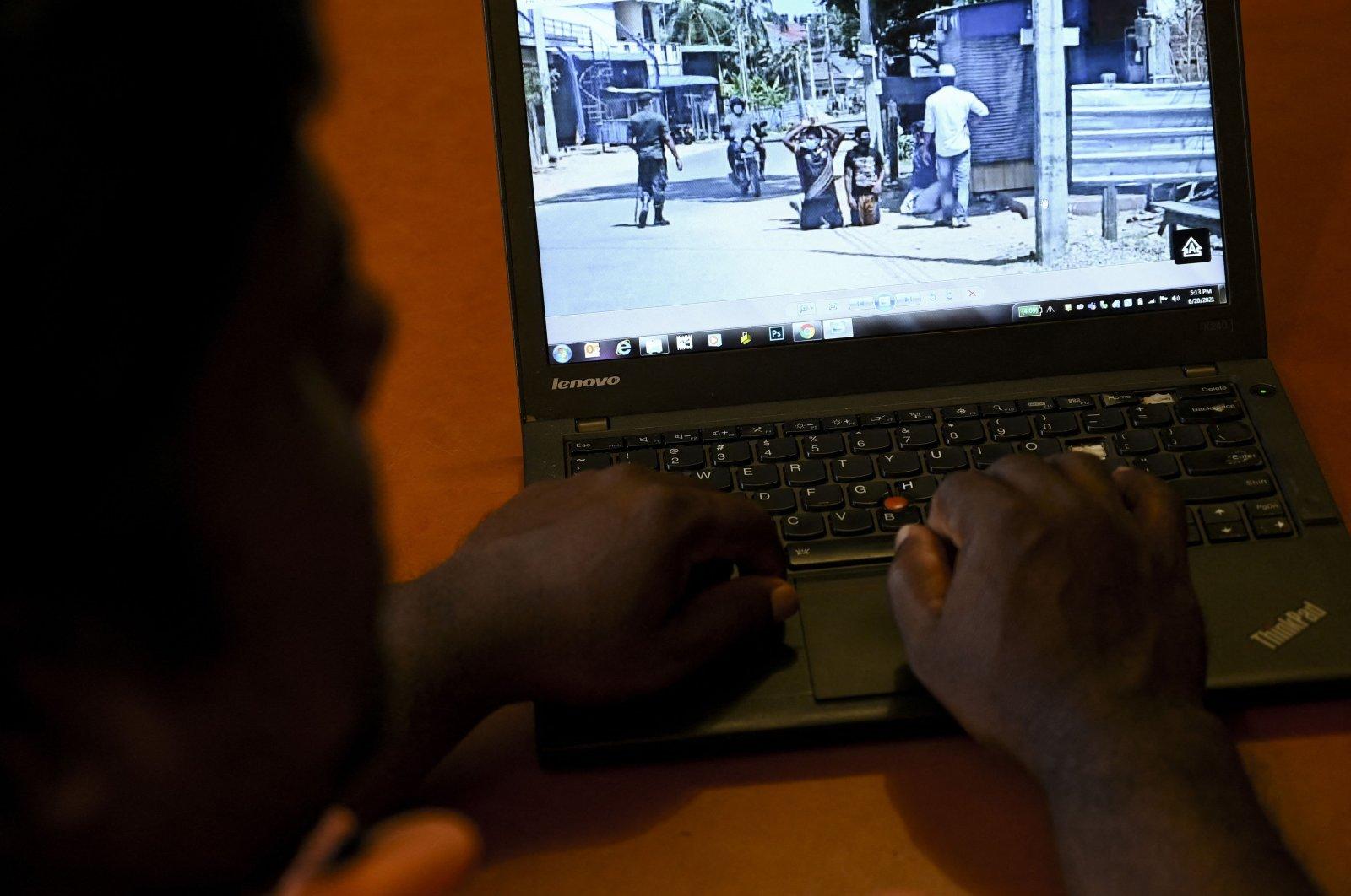 A user reads a social media post on his laptop, Colombo, Sri Lanka, June 20, 2021. (AFP Photo)