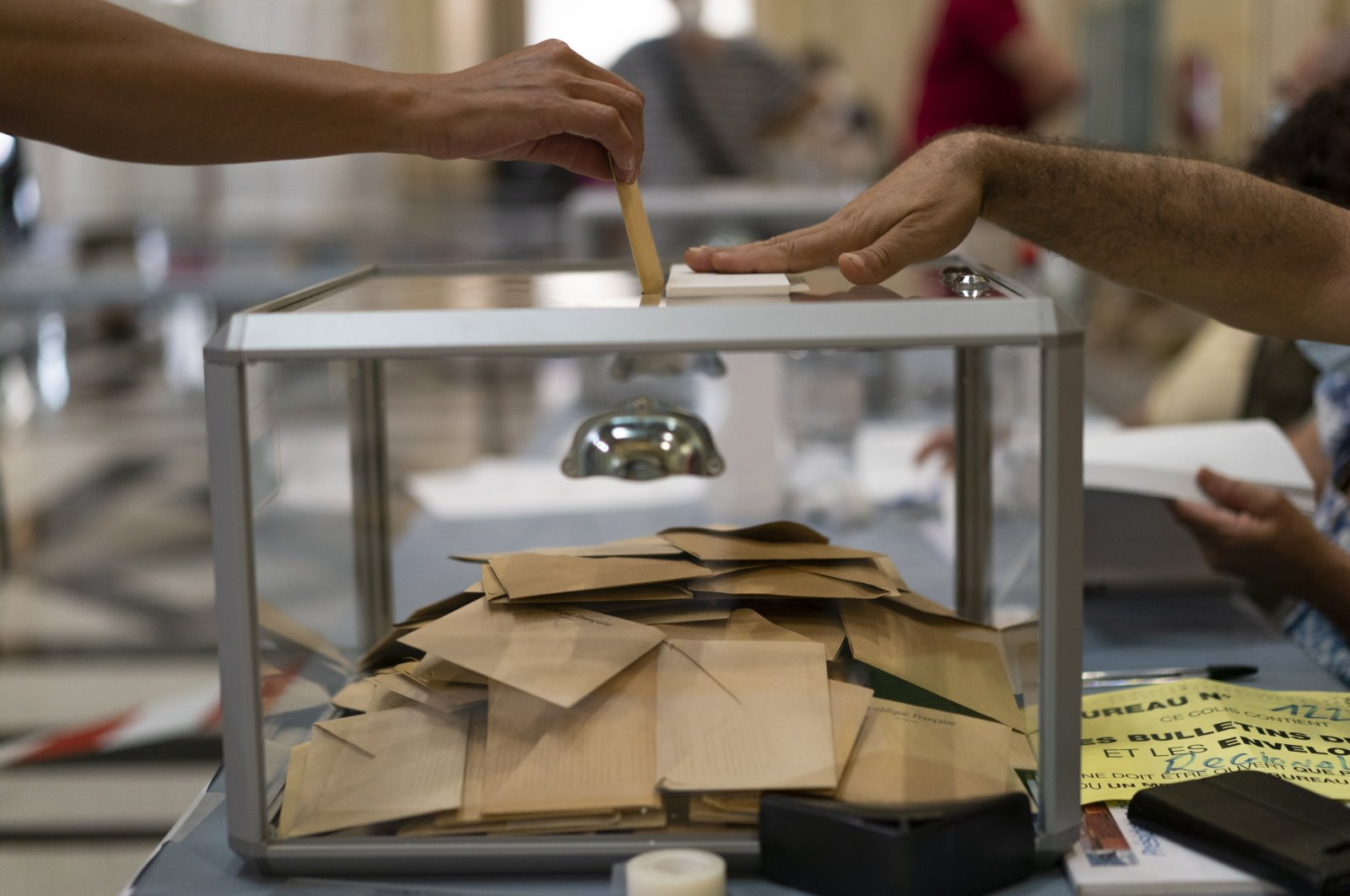 A woman casts her vote during regional elections in Marseille, southern France, June 20, 2021. (AP Photo)