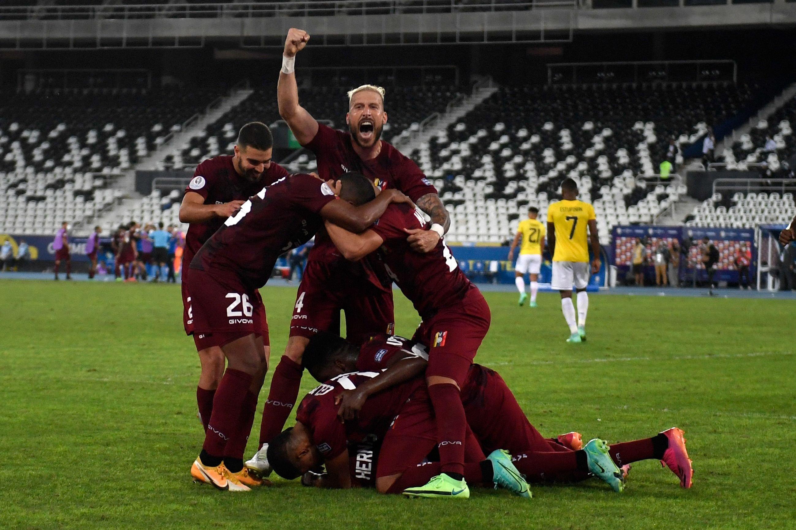 Venezuela players celebrate after scoring against Ecuador during their Copa America 2021 group match at the Nilton Santos Stadium in Rio de Janeiro, Brazil, June 20, 2021. (AFP Photo)