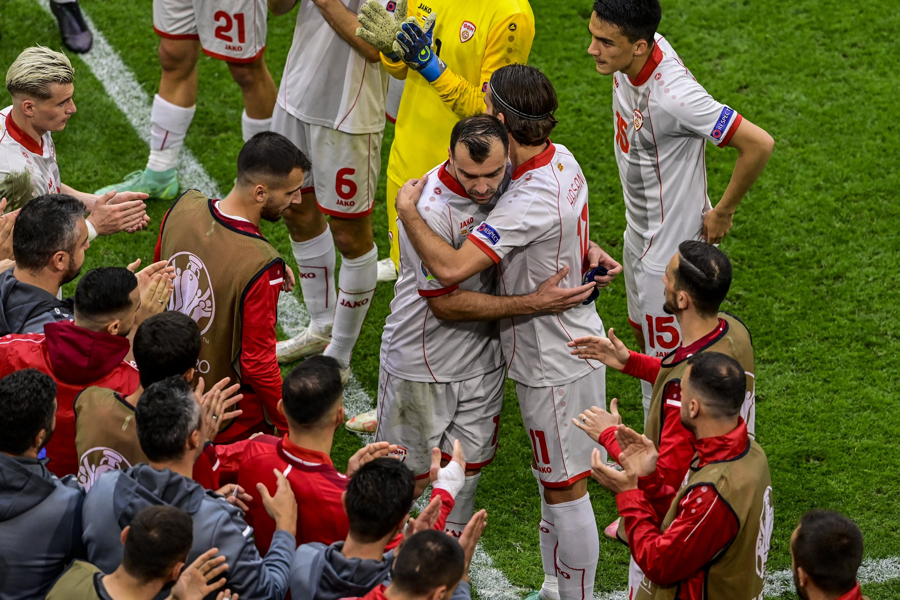North Macedonia's Goran Pandev (C) leaves the pitch while applauded and embraced by teammates during the UEFA Euro 2020 Group C match against the Netherlands at Johan Cruijff Arena in Amsterdam, Netherlands, June 21, 2021. (AP Photo/Olaf Kraak/Pool)