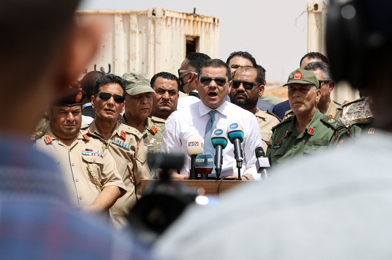 Libyan Interim Prime Minister Abdulhamid Dbeibah, delivers a speech in the town of Buwairat al-Hassoun, during a ceremony to mark the reopening of a 300-kilometer road between the cities of Misrata and Sirte, Libya, June 20, 2021. (AFP Photo)