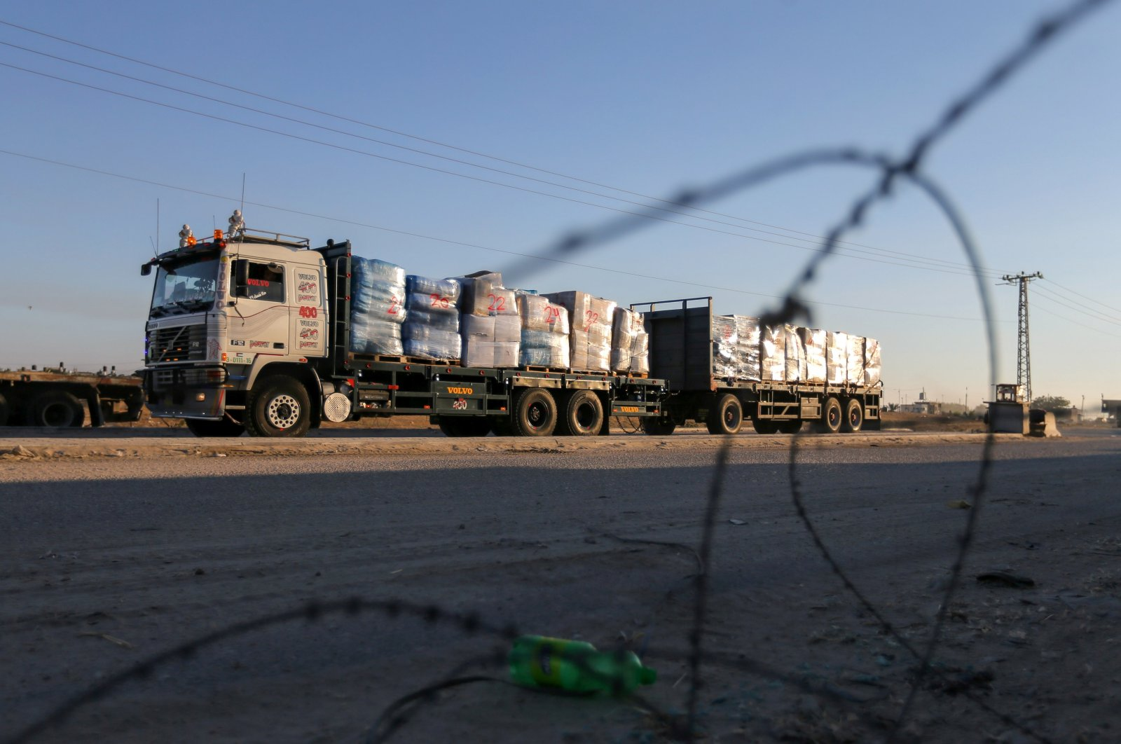A truck carrying clothes for export is seen at Kerem Shalom crossing in Rafah in the southern Gaza Strip, June 21, 2021. (Ibraheem Abu Mustafa/REUTERS)