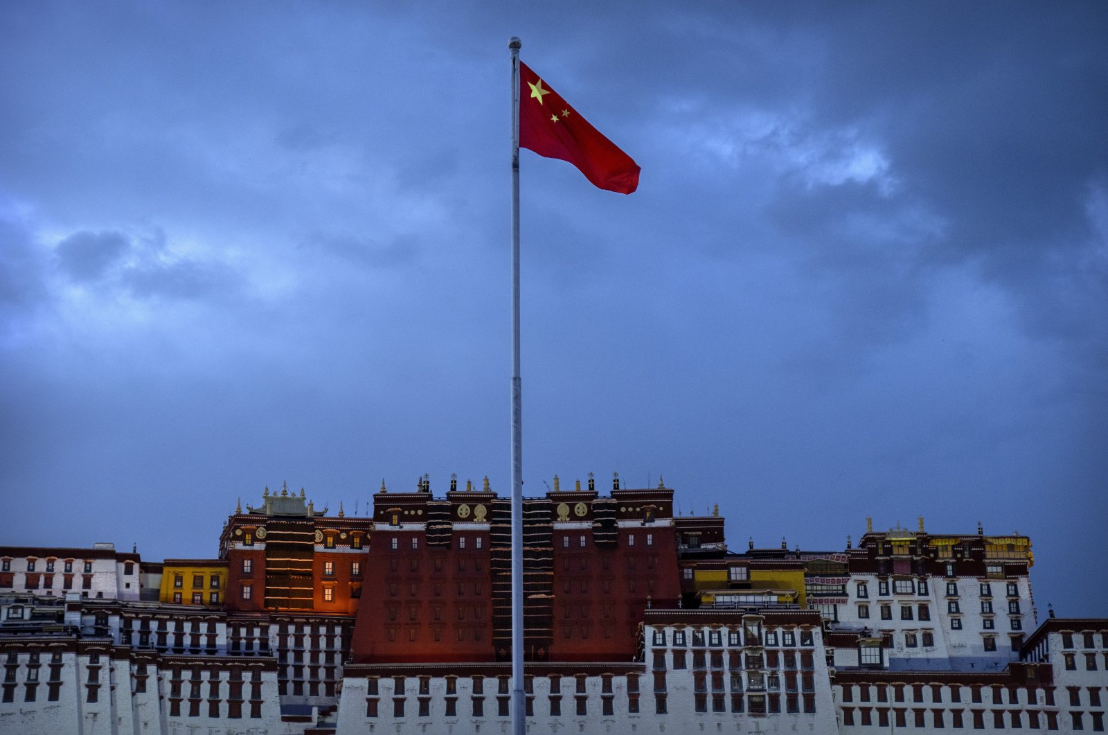 The Chinese flag flies at a plaza near the Potala Palace in Lhasa in western China's Tibet Autonomous Region, June 1, 2021. (AP Photo)