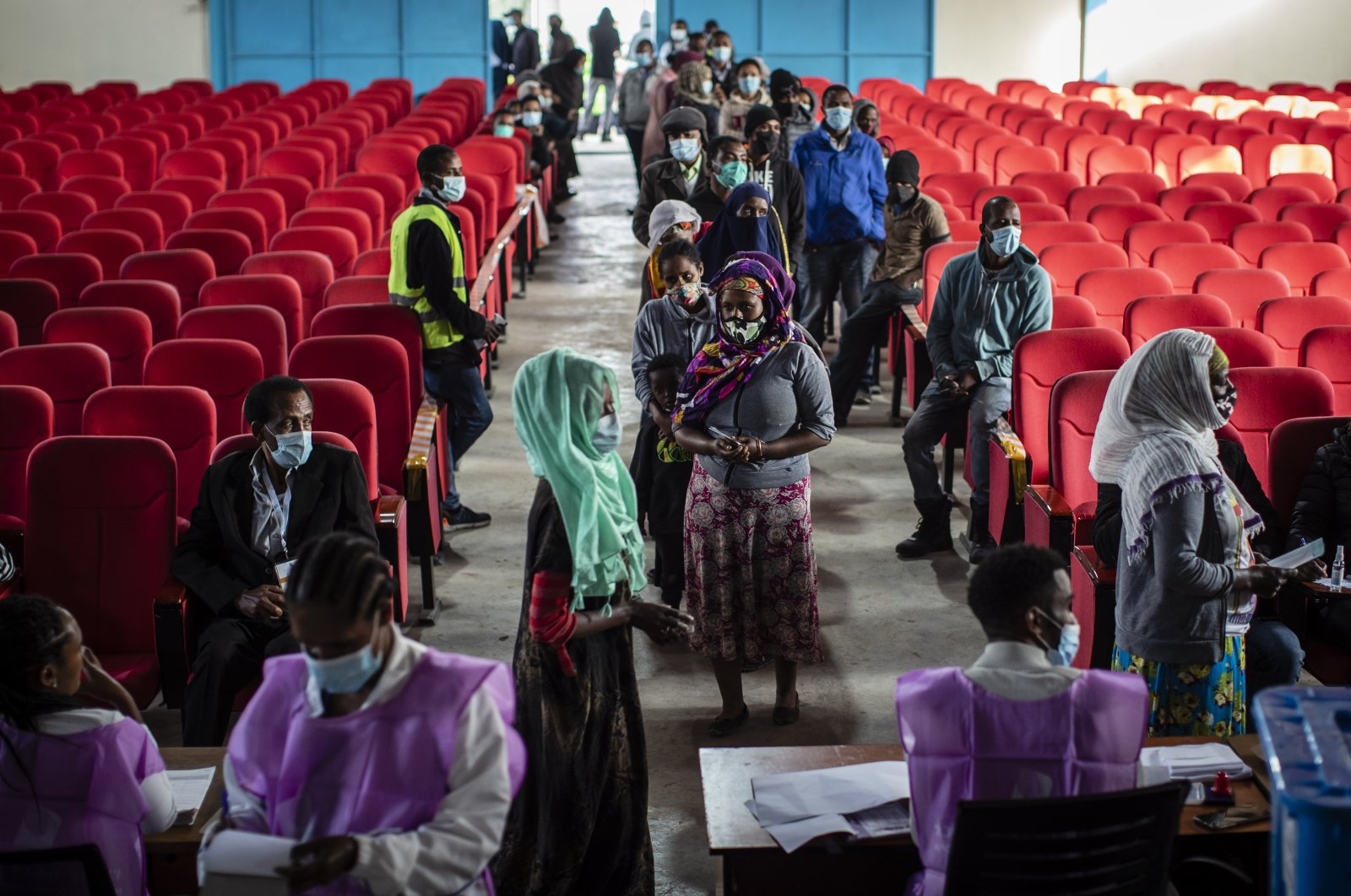 Ethiopians line up to cast their votes in the general election at a polling center in the capital Addis Ababa, Ethiopia, June 21, 2021. (AP Photo)
