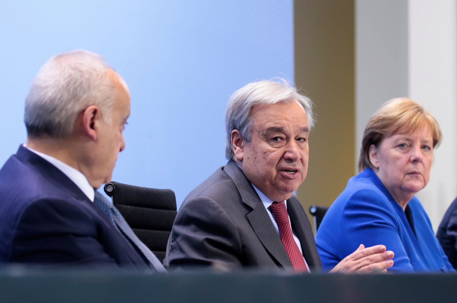 U.N. Secretary-General Antonio Guterres (C) speaks next to German Chancellor Angela Merkel (R) during a news conference at the end of a Peace summit on Libya at the Chancellery in Berlin on Jan. 19, 2020. (AFP File Photo)