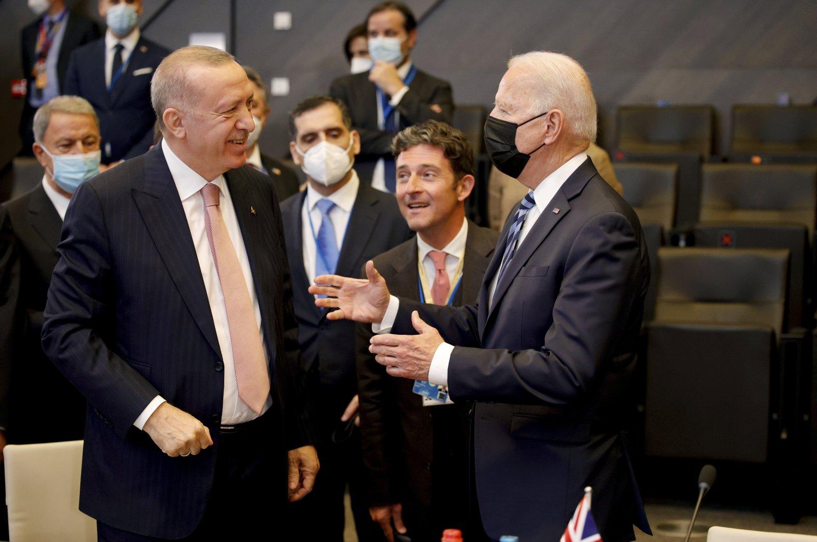 President Recep Tayyip Erdoğan (L) and U.S. President Joe Biden speak during a plenary session at a NATO summit in Brussels, Belgium, June 14, 2021. (AP Photo)