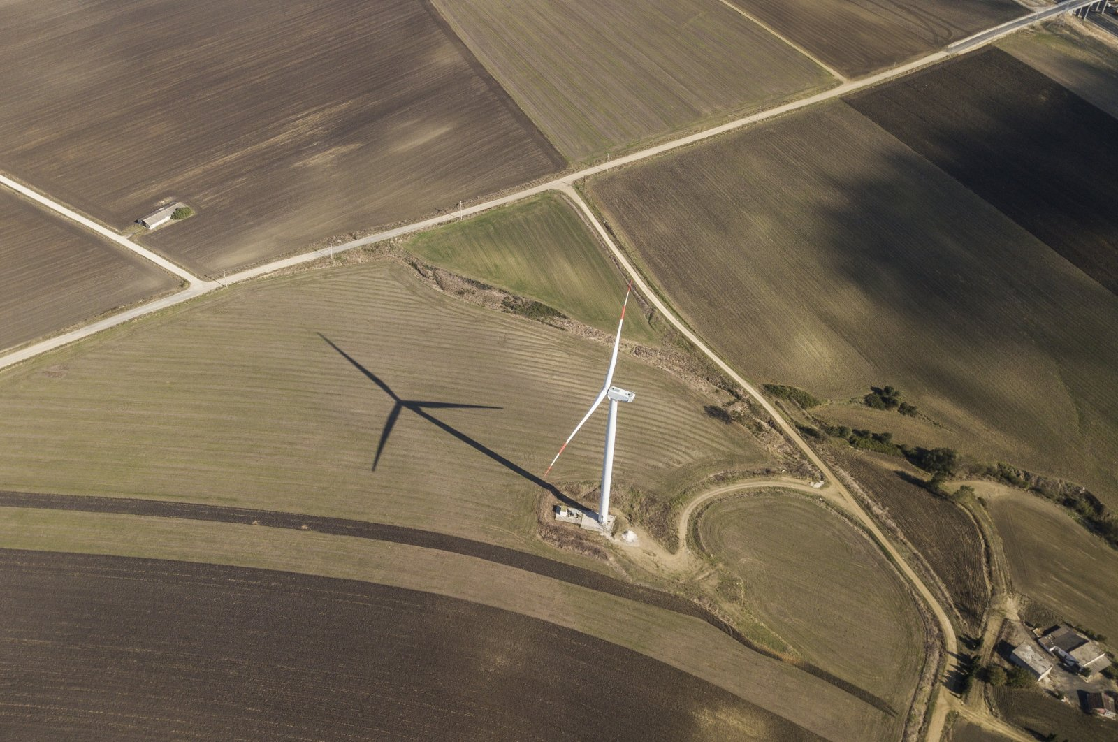 A wind tribune stands in the middle of farmlands in the countryside of Istanbul, Turkey, Oct. 22, 2020. (EPA Photo)