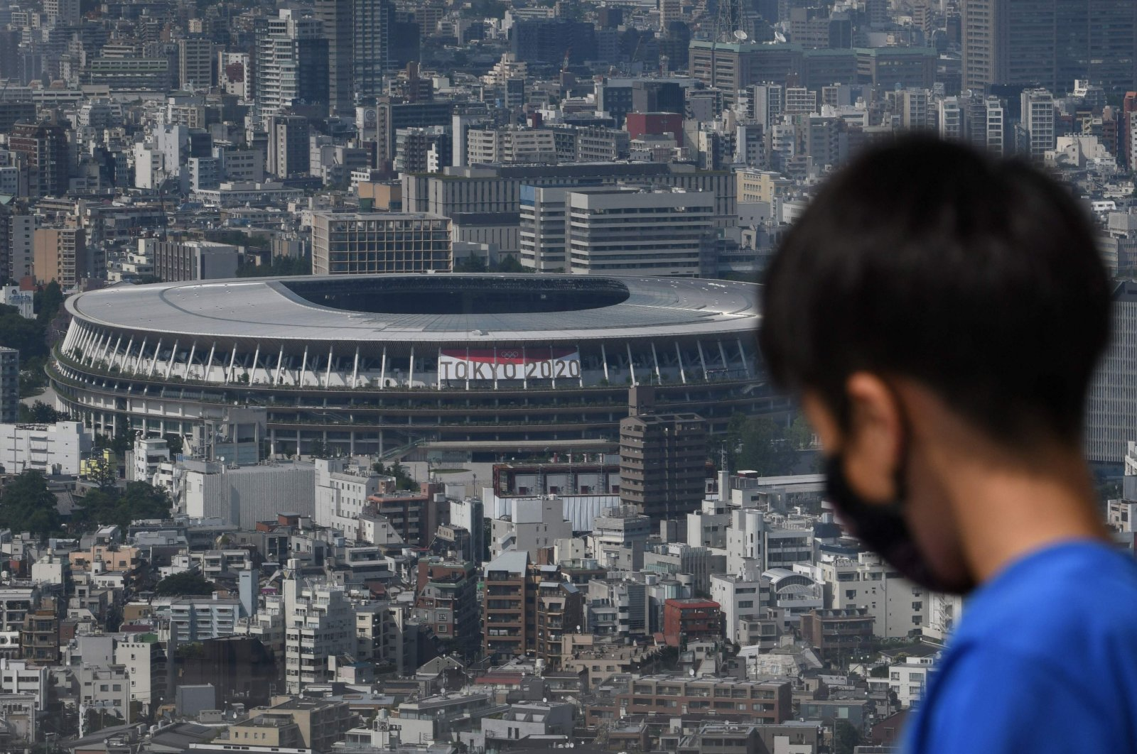 A general view of the National Stadium (L), the main venue for the 2020 Olympic and Paralympic Games in Tokyo, Japan, June 21, 2021. (AFP Photo)