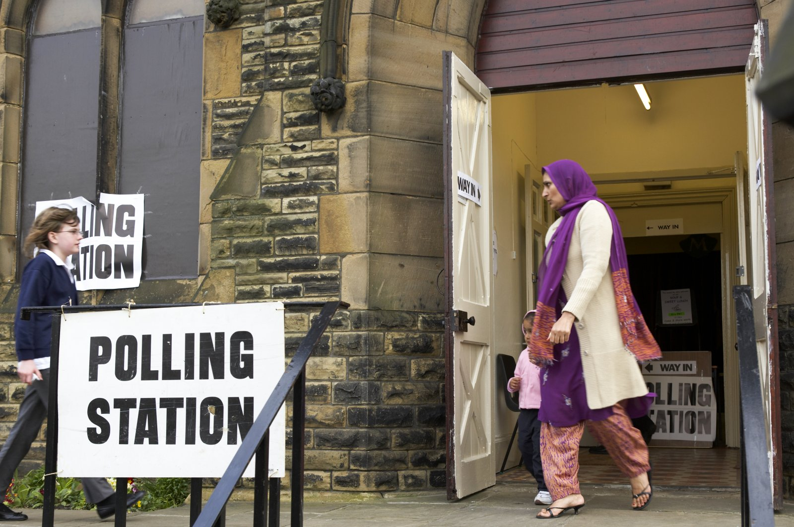 A Muslim British woman leaves a polling station after voting in an election, Dewsbury, West Yorkshire, U.K., May 8, 2005. (Shutterstock Photo)