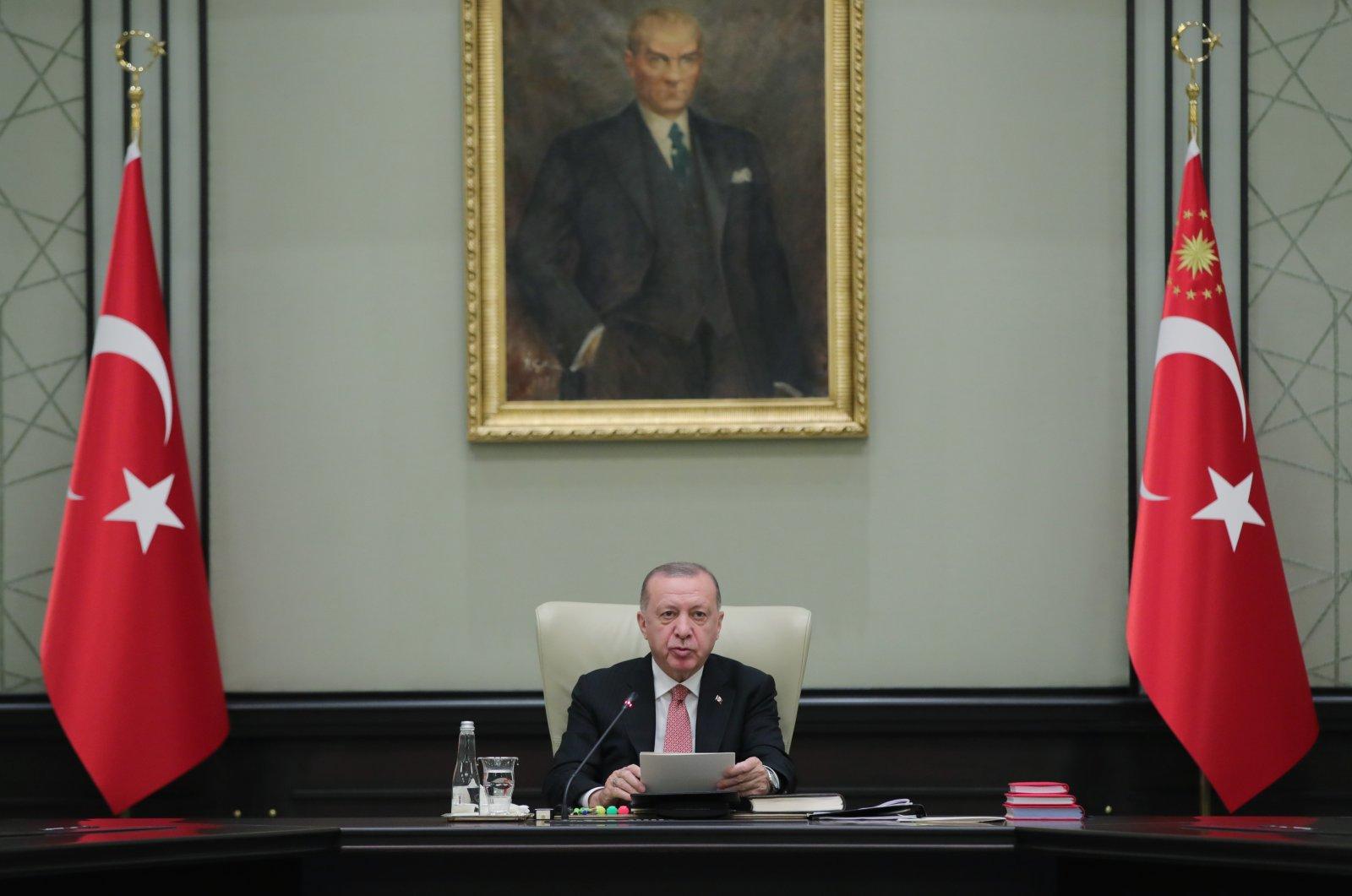 President Recep Tayyip Erdoğan prepares to start a Cabinet meeting at the Presidential Complex in Ankara, Turkey, June 21, 2021. (AA Photo)