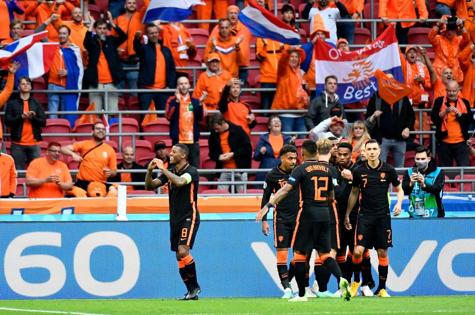 Netherlands captain Georginio Wijnaldum celebrates scoring his team's second goal with teammates during a UEFA Euro 2020 Group C match against North Macedonia at Johan Cruijff Arena, Amsterdam, Netherlands, June 21, 2021. (Reuters Photo/Pool/Piroschka Van De Wouw)