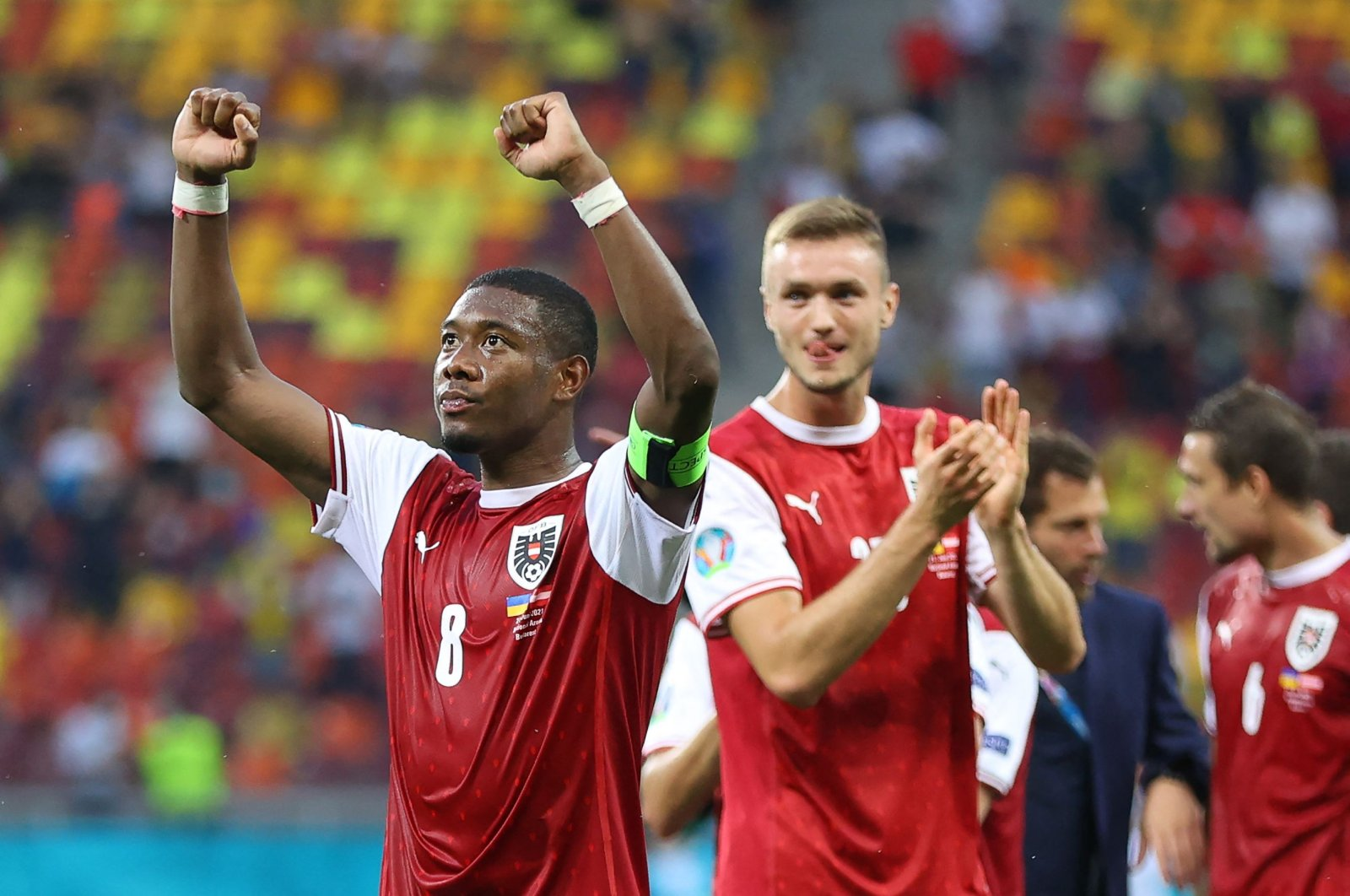 Austria's defender David Alaba (L) celebrates after winning the UEFA EURO 2020 Group C football match between Ukraine and Austria at the National Arena in Bucharest, Romania, June 21, 2021. (AFP Photo)