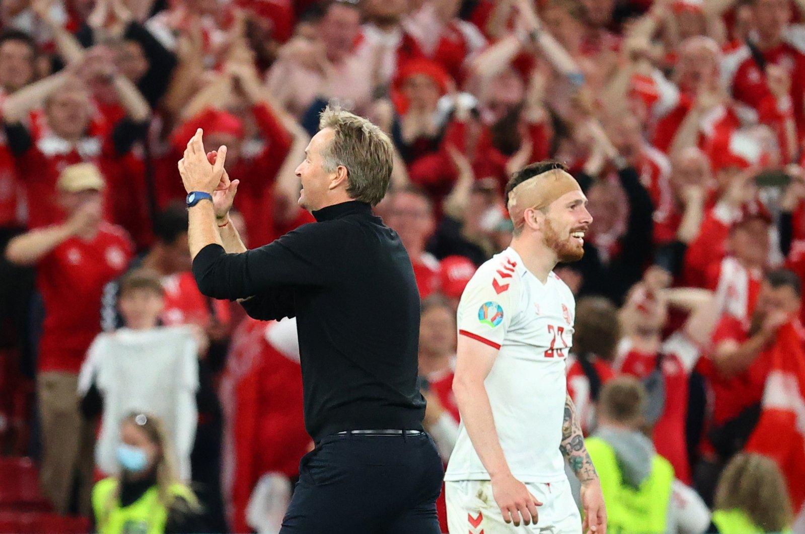 Denmark coach Kasper Hjulmand (L) and Pierre-Emile Hojbjerg celebrate after the Euro 2020 Group B match against Russia at Parken Stadium, Copenhagen, Denmark, June 21, 2021. (Reuters Photo)