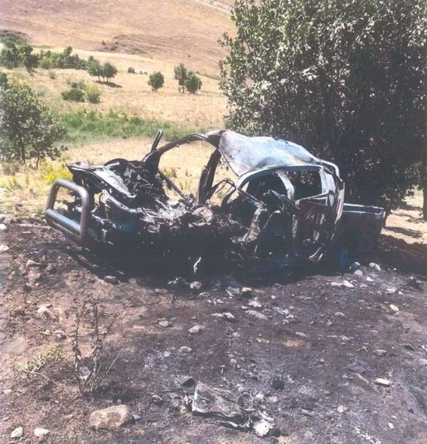 A destroyed vehicle is seen in this photo taken at an undisclosed location in northern Iraq. (AA Photo)