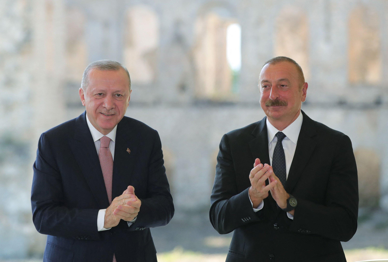 President Recep Tayyip Erdoğan (L) and Azerbaijani President Ilham Aliyev clap after signing 'the Shusha Declaration' in Shusha, Azerbaijan, June 15, 2021. (AFP Photo)