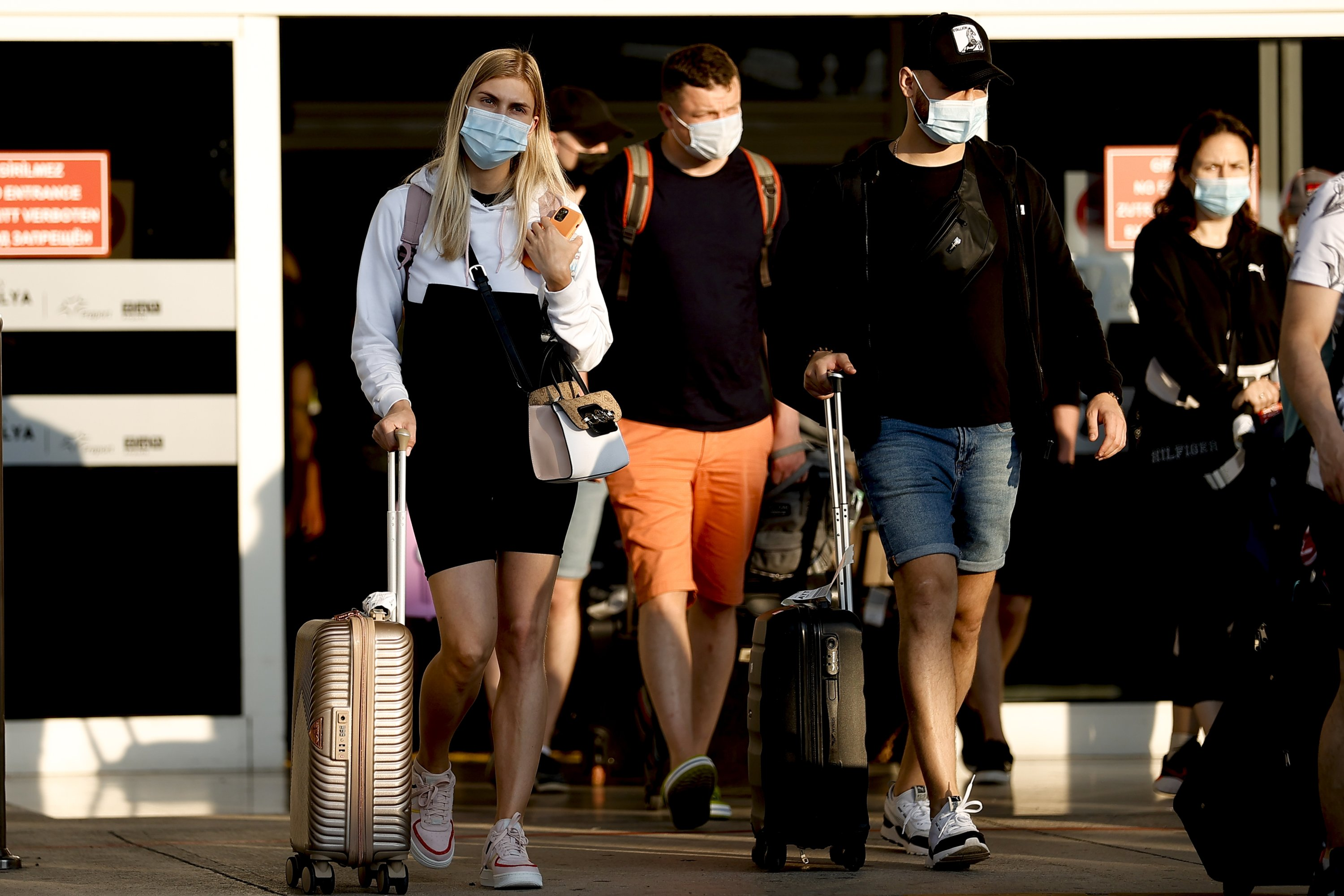Russian tourists exit the airport as they arrive in the southern province of Antalya, Turkey, June 22, 2021. (AA Photo)