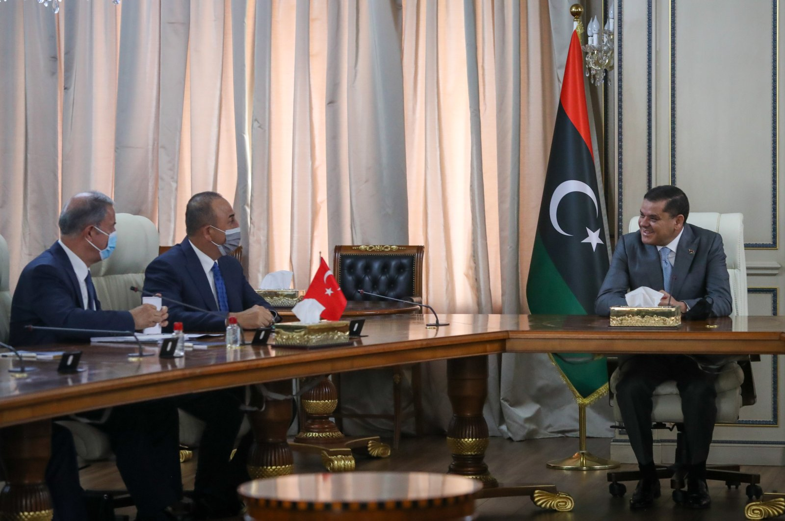 Foreign Minister Mevlüt Çavuşoğlu (C) and Defense Minister Hulusi Akar (L) attend a meeting with Libyan Prime Minister Abdul Hamid Mohammed  Dbeibah in Tripoli, Libya, May 4, 2021. (AA Photo)