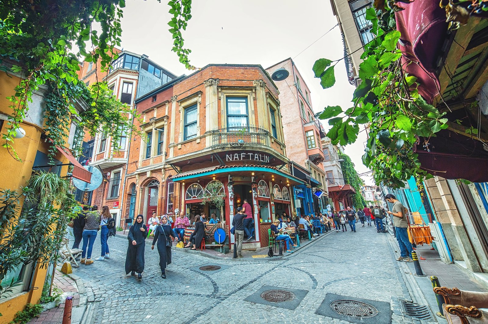 People mill about in the colorful streets and cafes of the Balat neighborhood in Istanbul, Turkey, Oct. 20, 2018. (Shutterstock Photo)