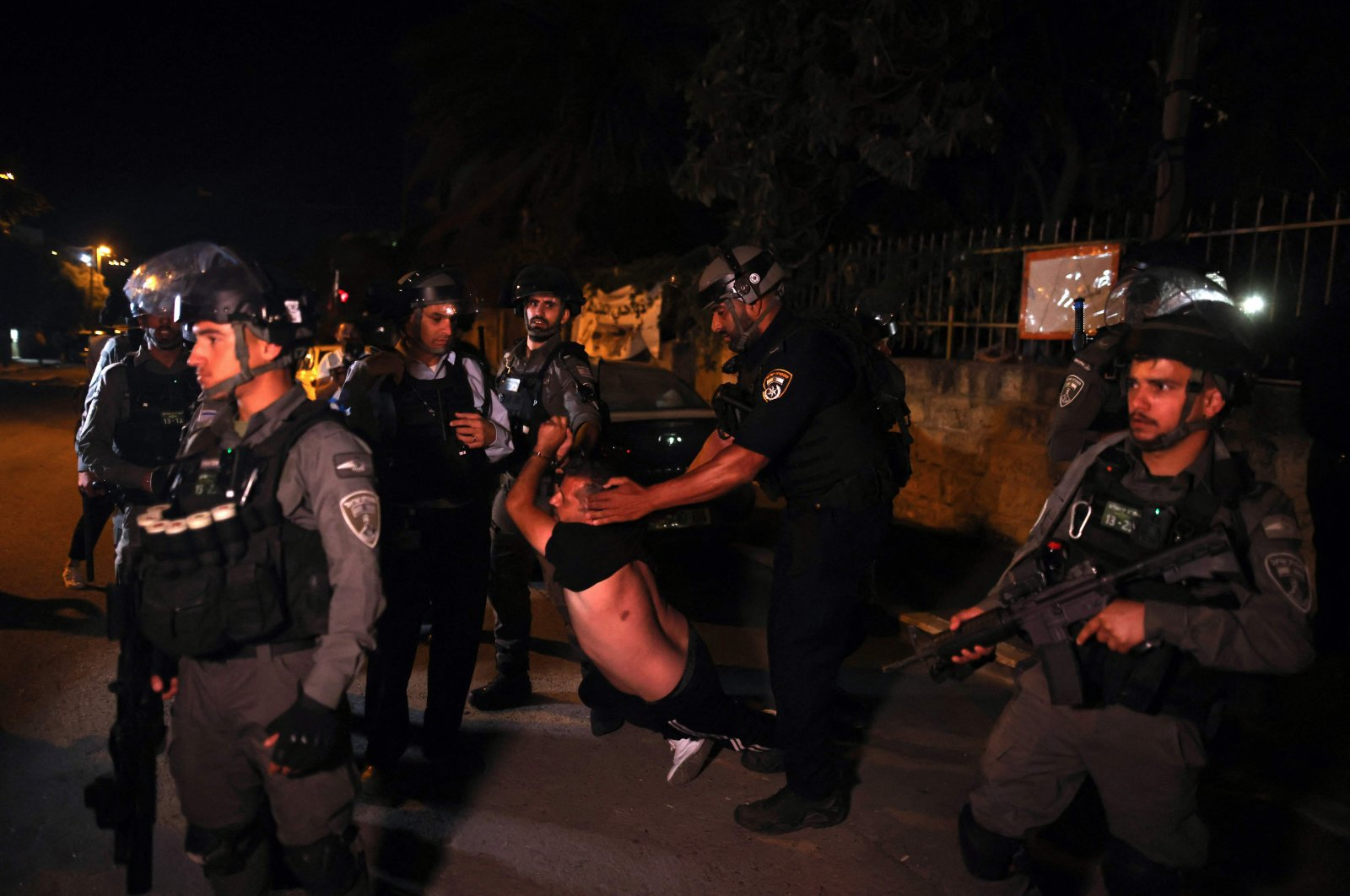 A Palestinian demonstrator is arrested by Israeli security forces while protesting the eviction of Palestinian families in the Sheikh Jarrah neighborhood of occupied East Jerusalem, Palestine, June 21, 2021. (AFP Photo)