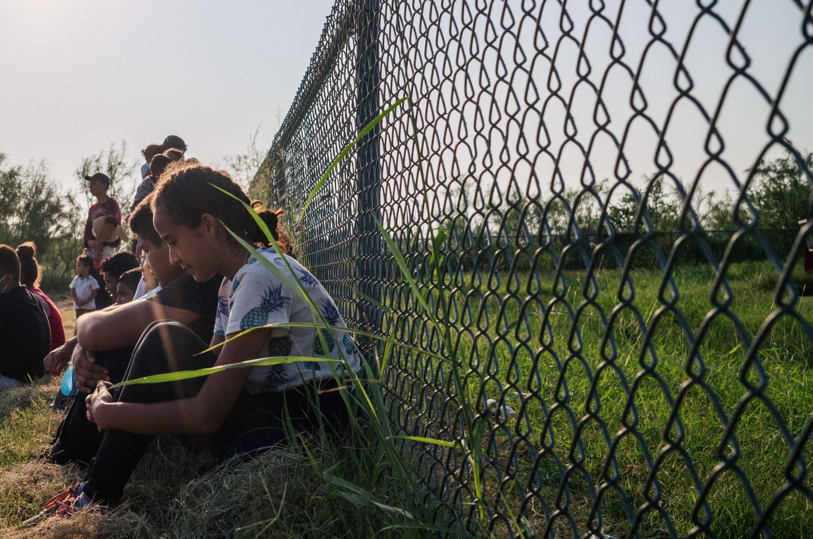 Immigrants from Honduras wait to be accounted for and taken to a border patrol processing facility after crossing the Rio Grande into the U.S., in La Joya, Texas, U.S., June 21, 2021. (AFP Photo)